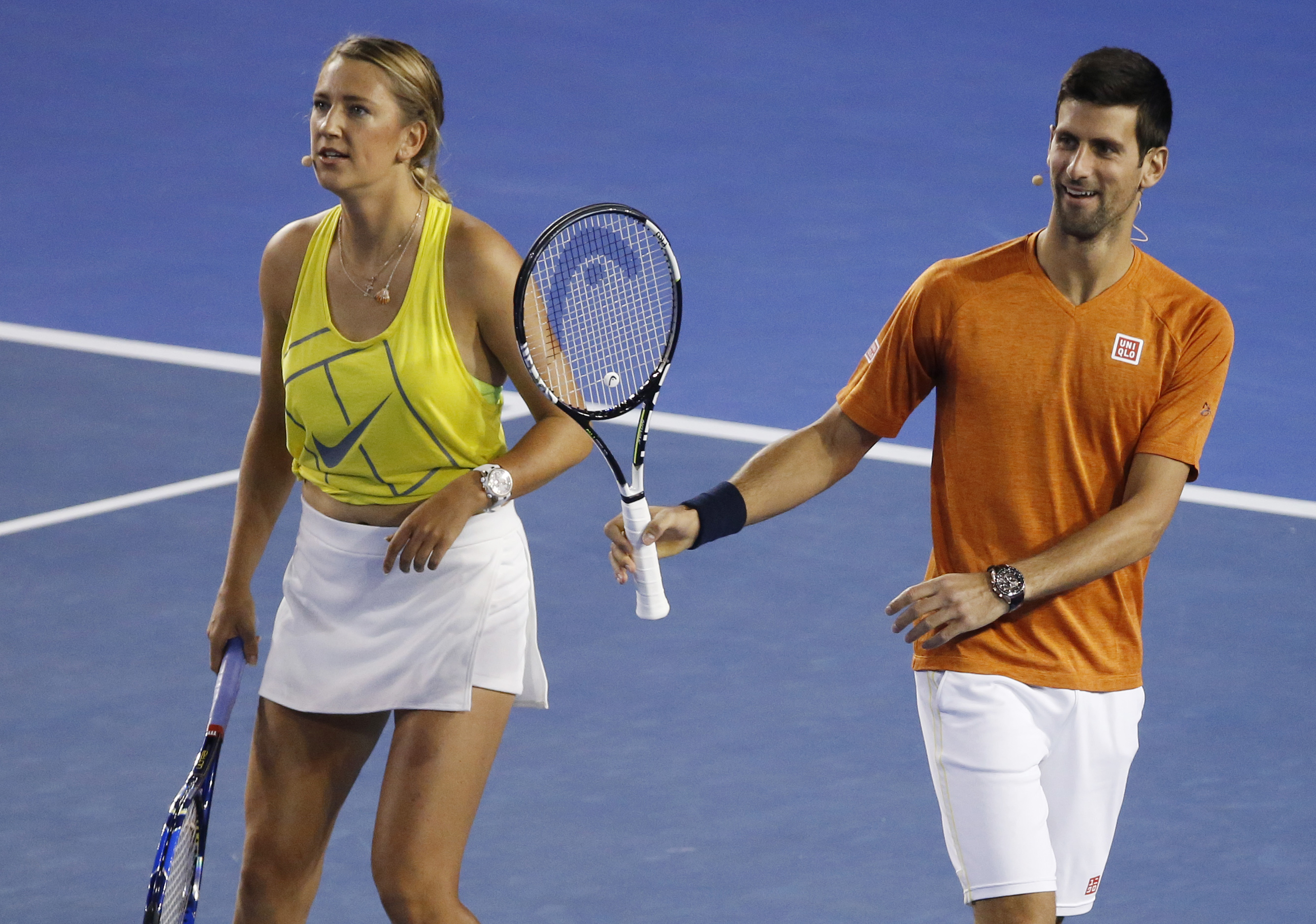 Victoria Azarenka of Belarus and Serbia's Novak Djokovic participate in the Kids Tennis Day, an exhibition event on Rod Laver Arena ahead of the Australian Open tennis championships in Melbourne, Australia, Saturday, Jan. 16, 2016. (AP Photo/Vincent Thian
