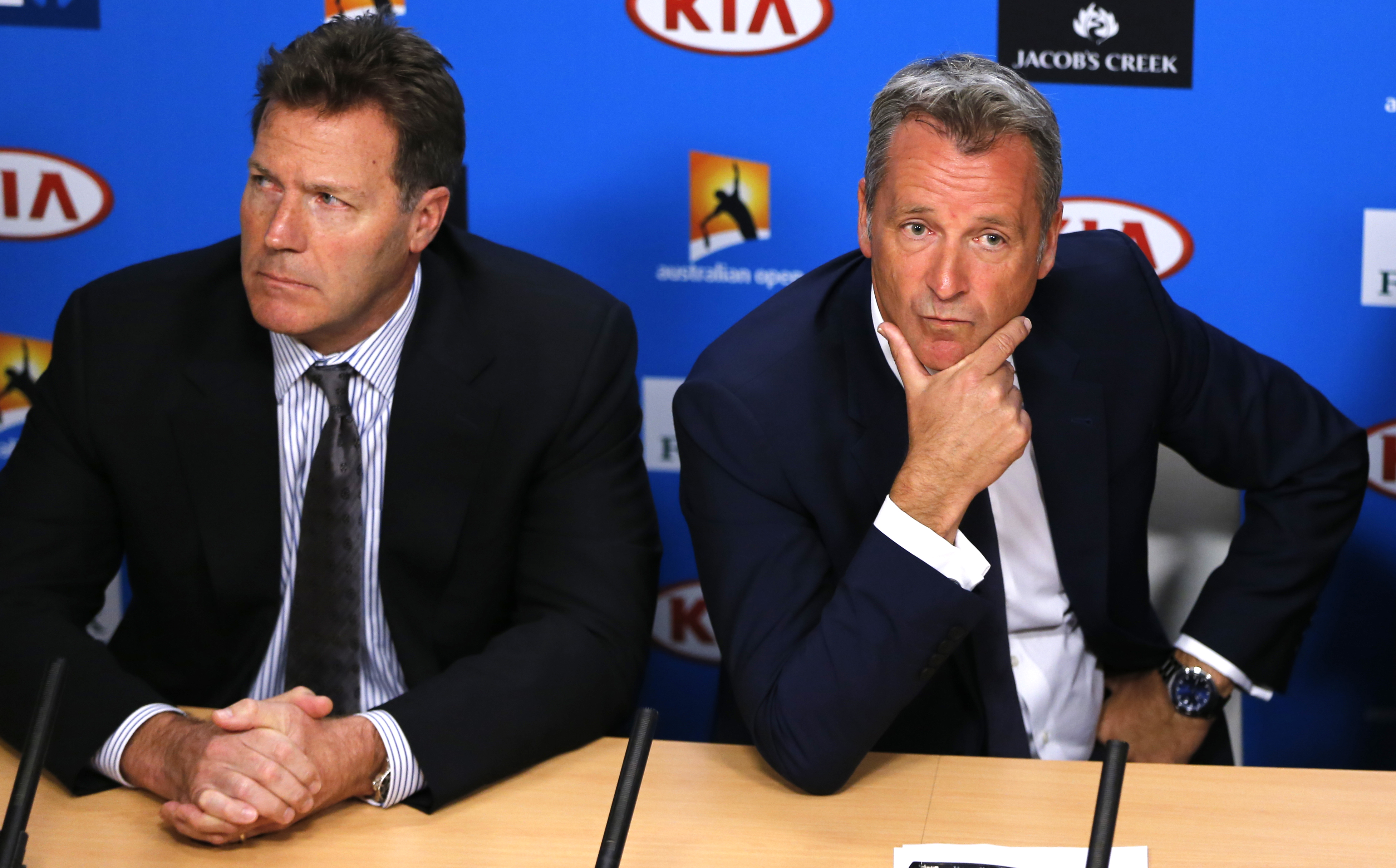 ATP chairman Chris Kermode, right,  and vice chairman Mark Young listen to reporter's question during a press conference at the Australian Open tennis championships in Melbourne, Australia, Monday, Jan. 18, 2016. Chairman Kermode and the Tennis Integrity