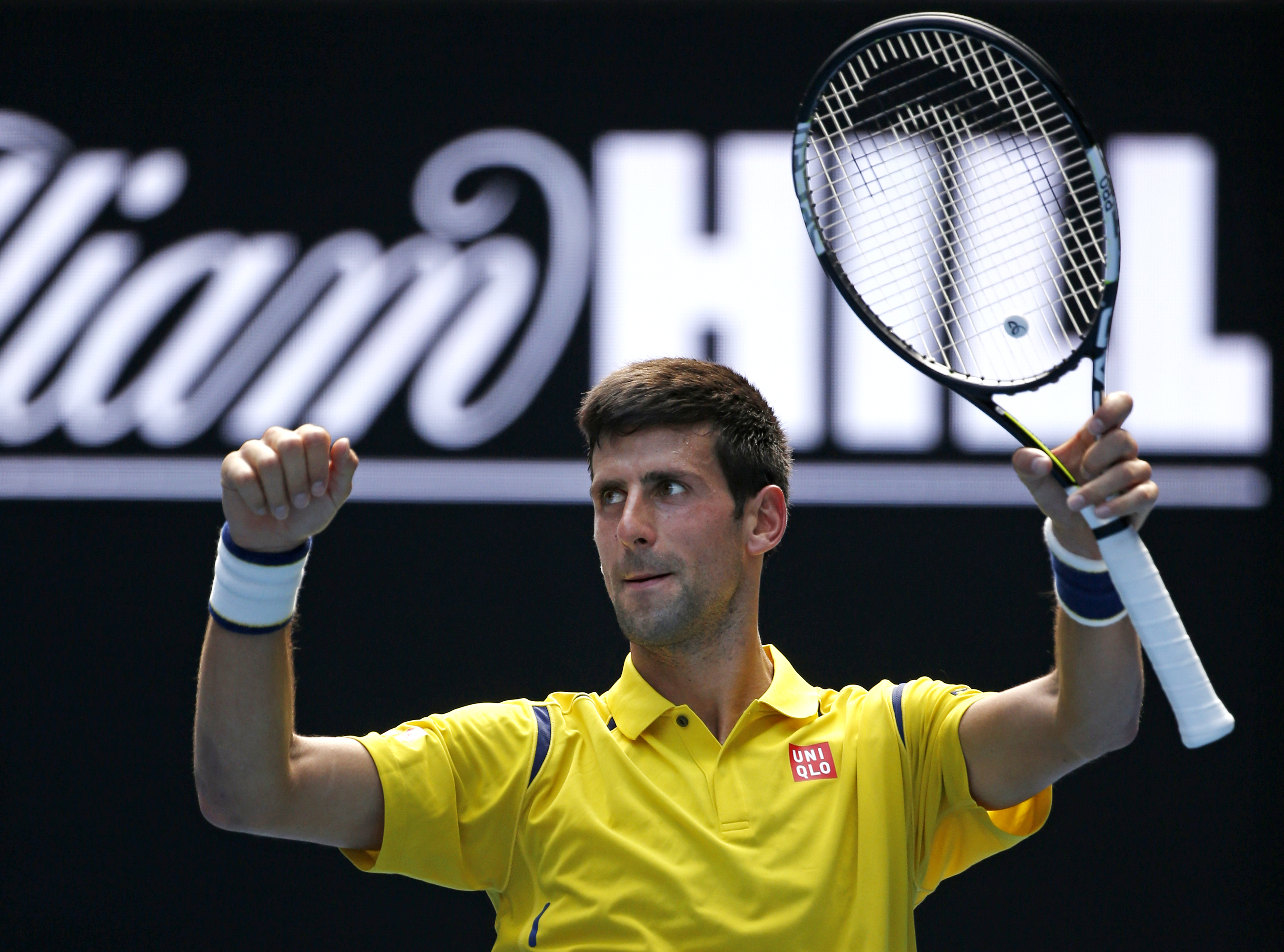 Novak Djokovic of Serbia celebrates after defeating Chung Hyeon of South Korea during their first round match at the Australian Open tennis championships in Melbourne, Australia, Monday, Jan. 18, 2016.(AP Photo/Vincent Thian)