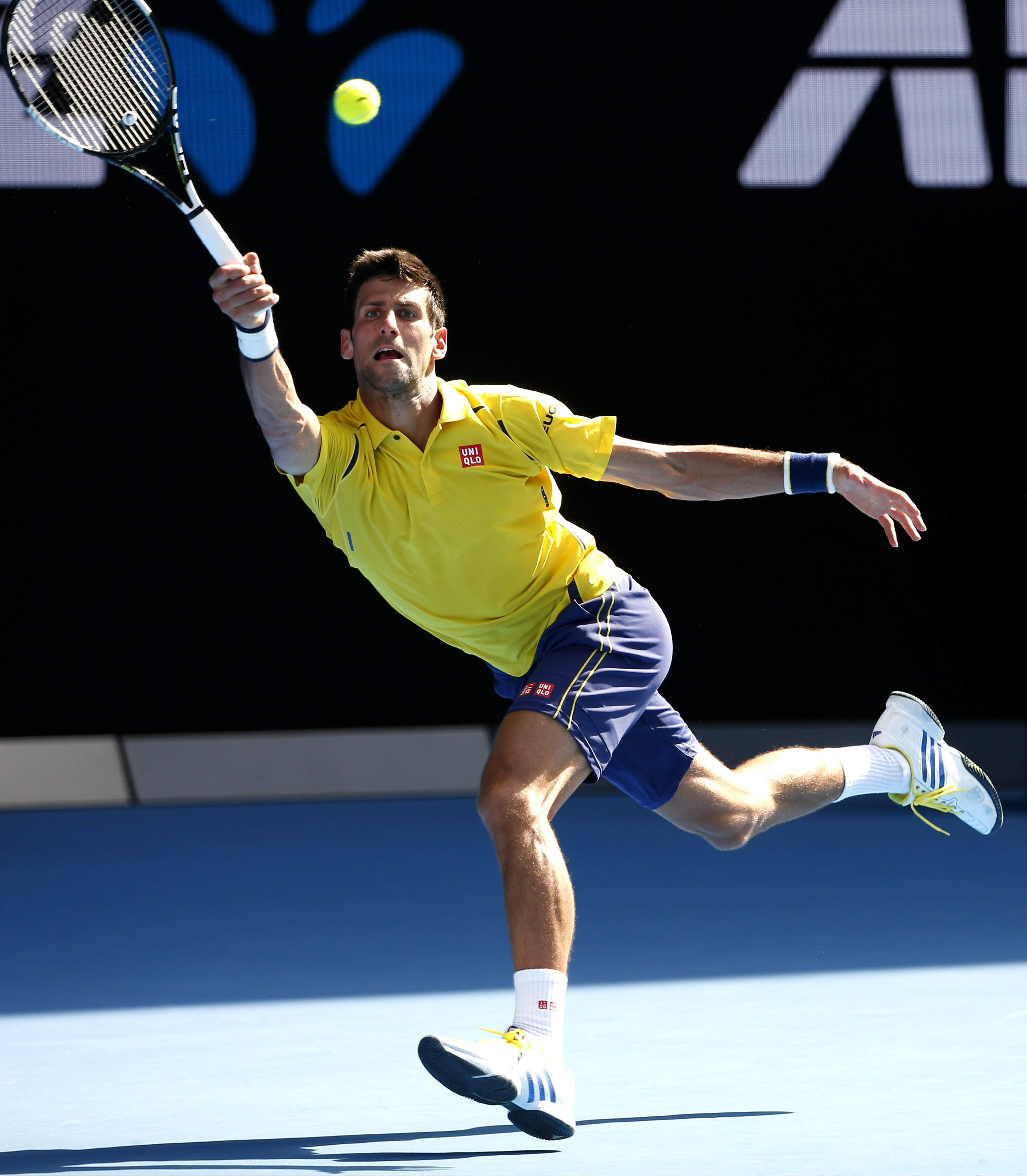 Novak Djokovic of Serbia reaches for a shot during his first round match against Chung Hyeon of South Korea  at the Australian Open tennis championships in Melbourne, Australia, Monday, Jan. 18, 2016.(AP Photo/Vincent Thian)