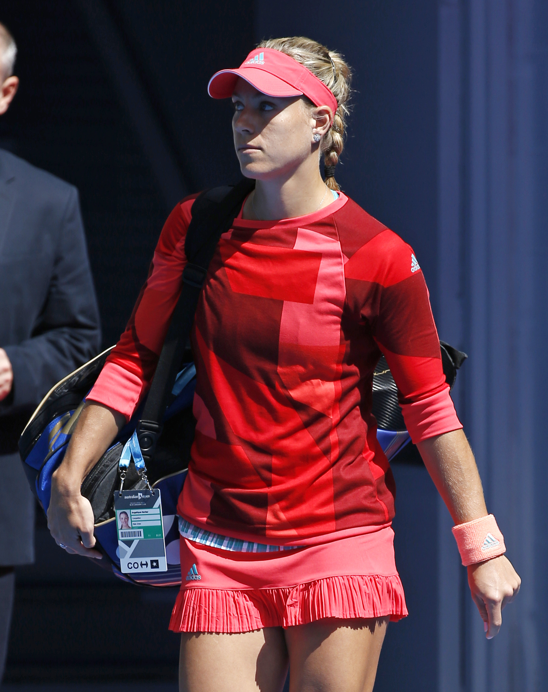 Angelique Kerber of Germany walks onto Rod Laver Arena for her fourth round match against compatriot Annika Beck at the Australian Open tennis championships in Melbourne, Australia, Monday, Jan. 25, 2016.(AP Photo/Vincent Thian)