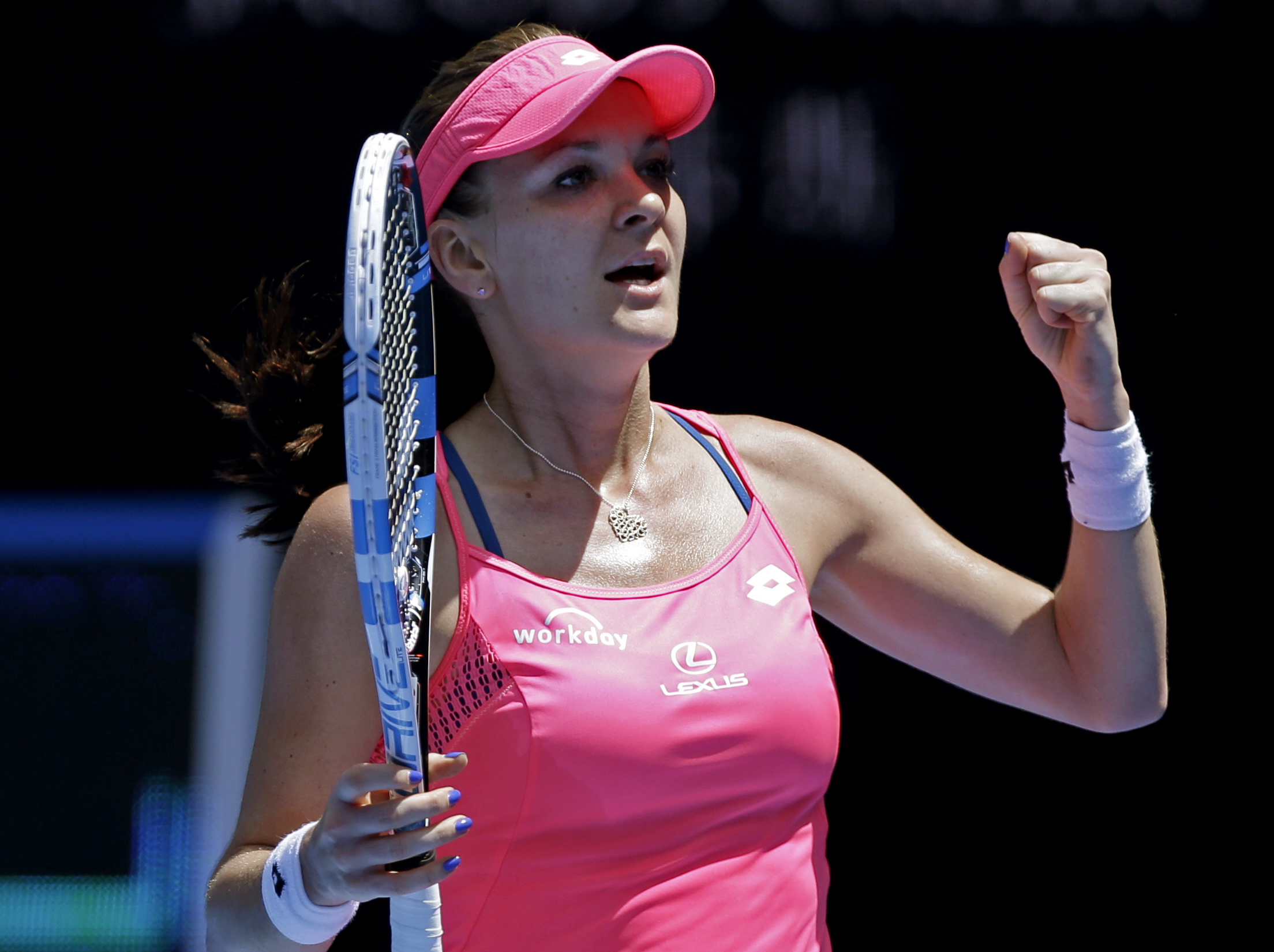 Agnieszka Radwanska of Poland celebrates after defeating Carla Suarez Navarro of Spain in their quarterfinal match at the Australian Open tennis championships in Melbourne, Australia, Tuesday, Jan. 26, 2016.(AP Photo/Aaron Favila)