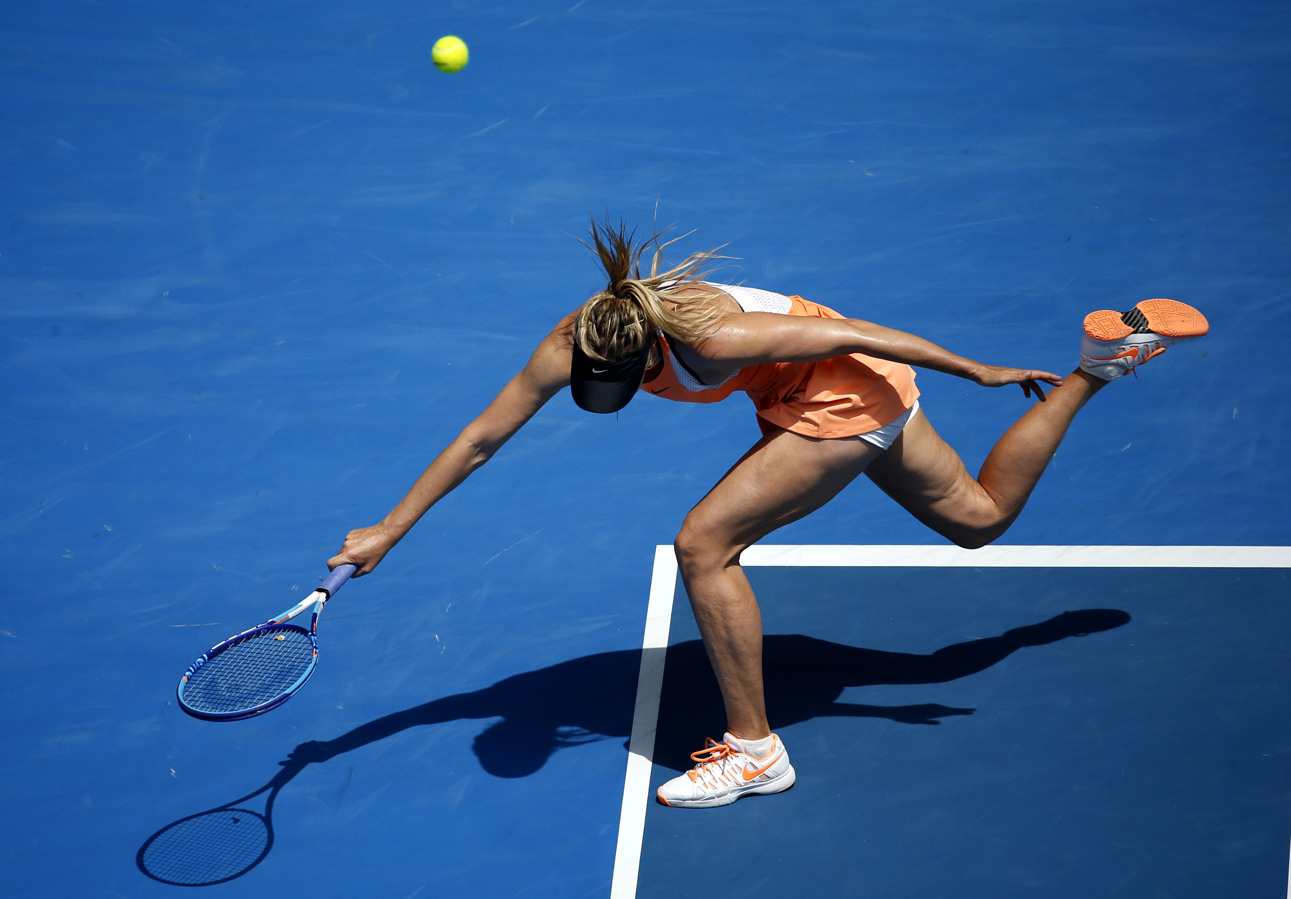 Maria Sharapova of Russia fails to return a shot to Serena Williams of the United States during their quarterfinal match at the Australian Open tennis championships in Melbourne, Australia, Tuesday, Jan. 26, 2016.(AP Photo/Vincent Thian)