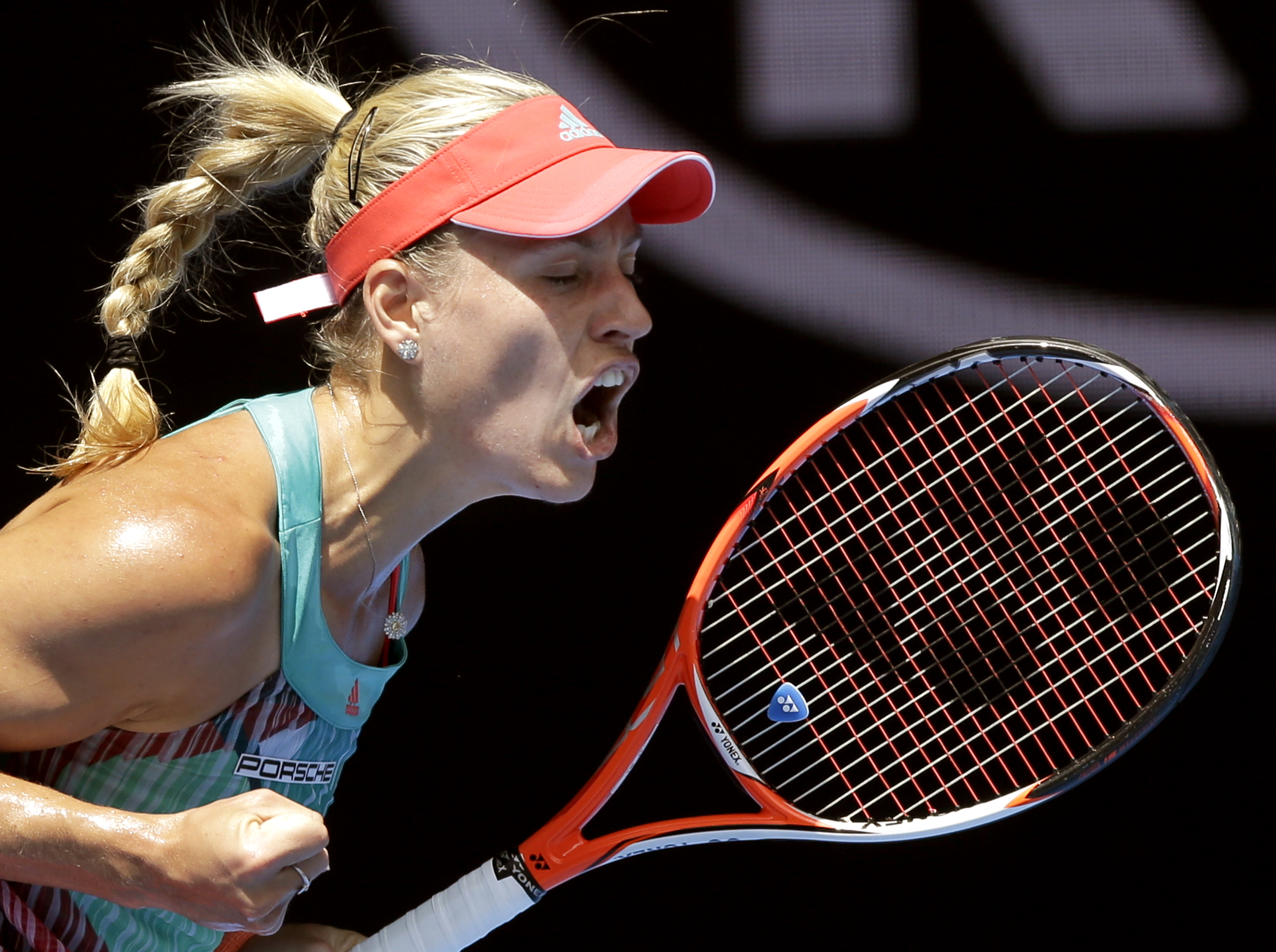 Angelique Kerber of Germany celebrates after winning a point against Victoria Azarenka of Belarus during their quarterfinal match at the Australian Open tennis championships in Melbourne, Australia, Wednesday, Jan. 27, 2016.(AP Photo/Aaron Favila)