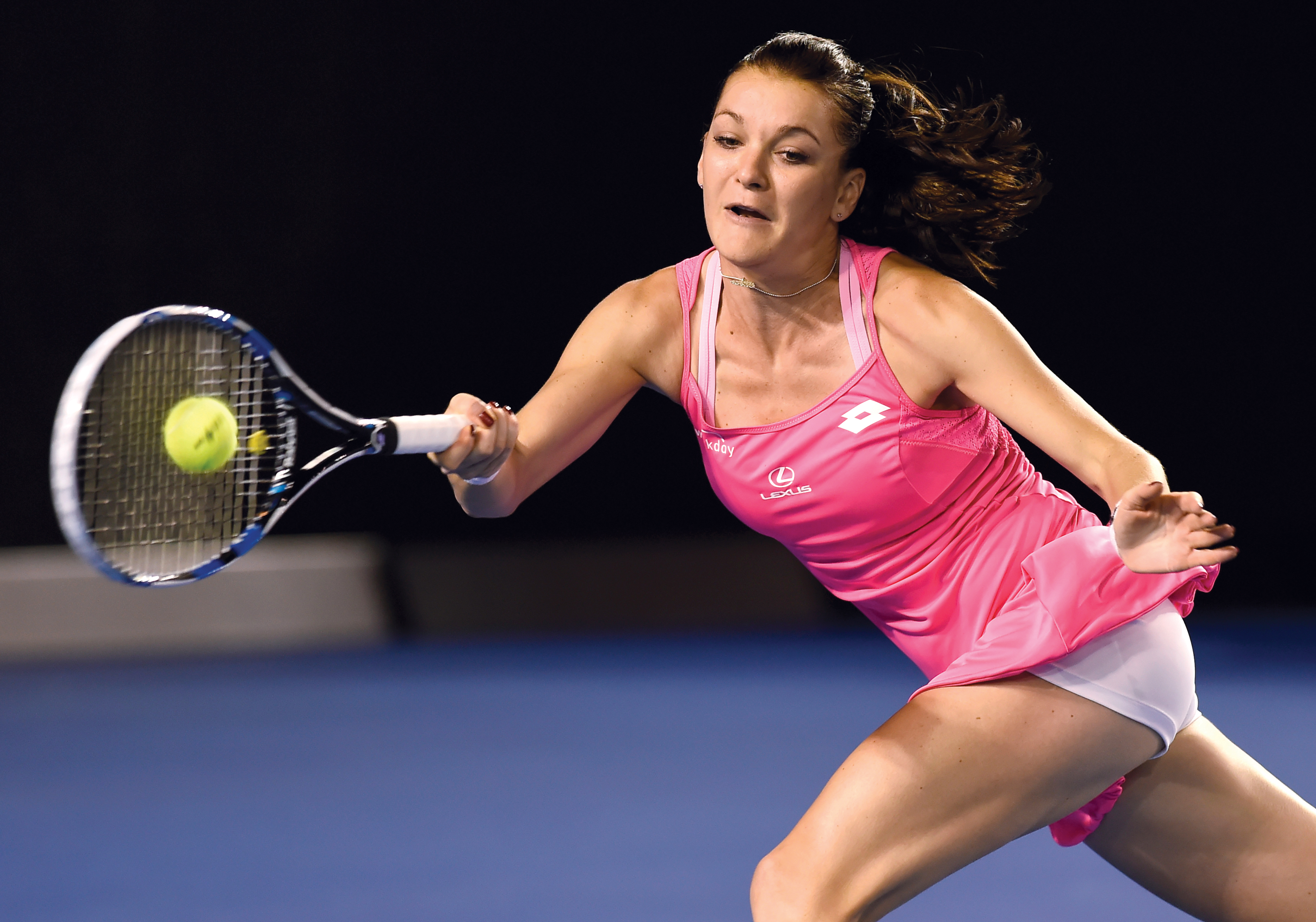 Agnieszka Radwanska of Poland plays a forehand return to Serena Williams of the United States during their semifinal match at the Australian Open tennis championships in Melbourne, Australia, Thursday, Jan. 28, 2016.(AP Photo/Andrew Brownbill)