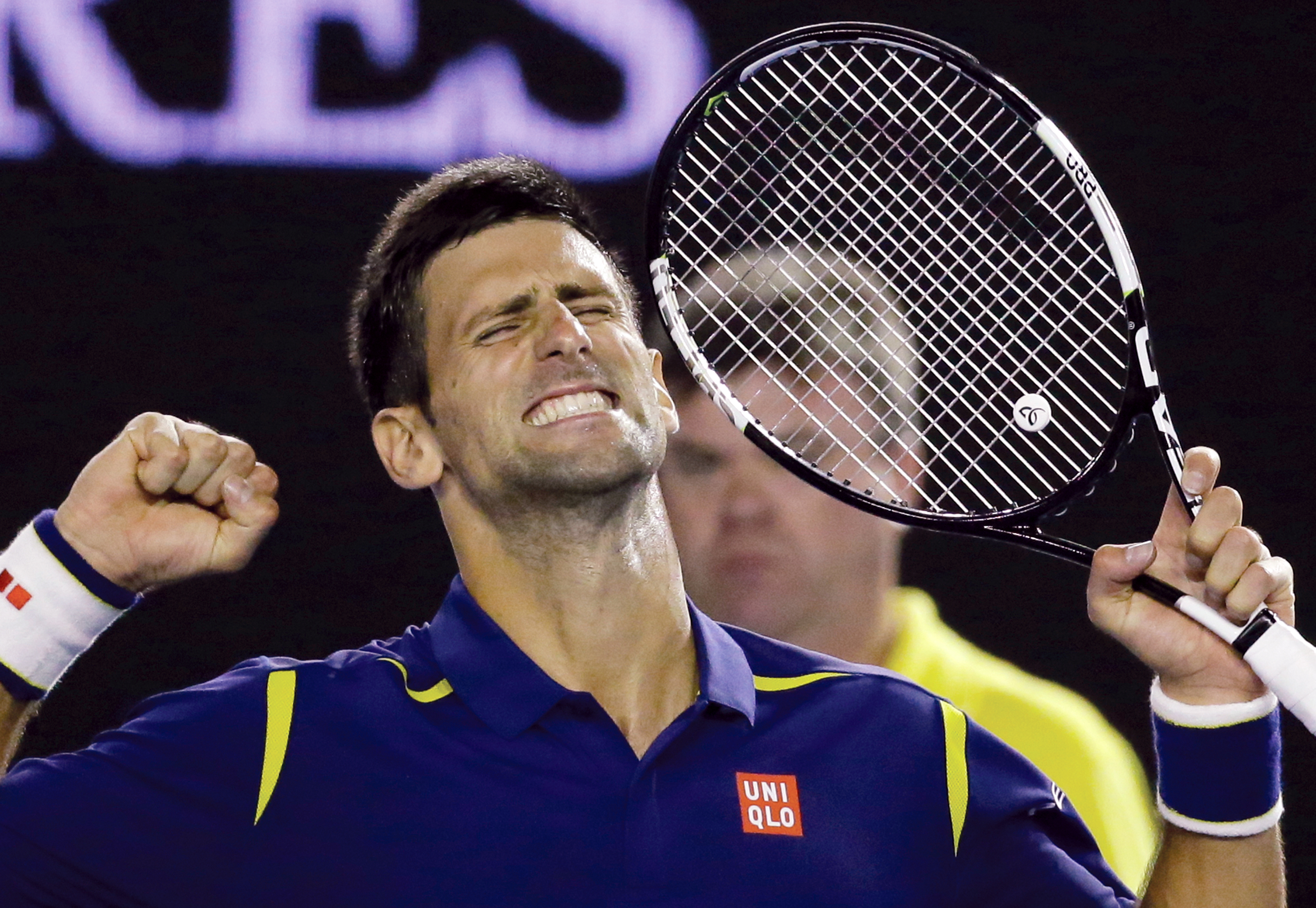 Novak Djokovic of Serbia celebrates after defeating Roger Federer of Switzerland in their semifinal match at the Australian Open tennis championships in Melbourne, Australia, Thursday, Jan. 28, 2016.(AP Photo/Aaron Favila)