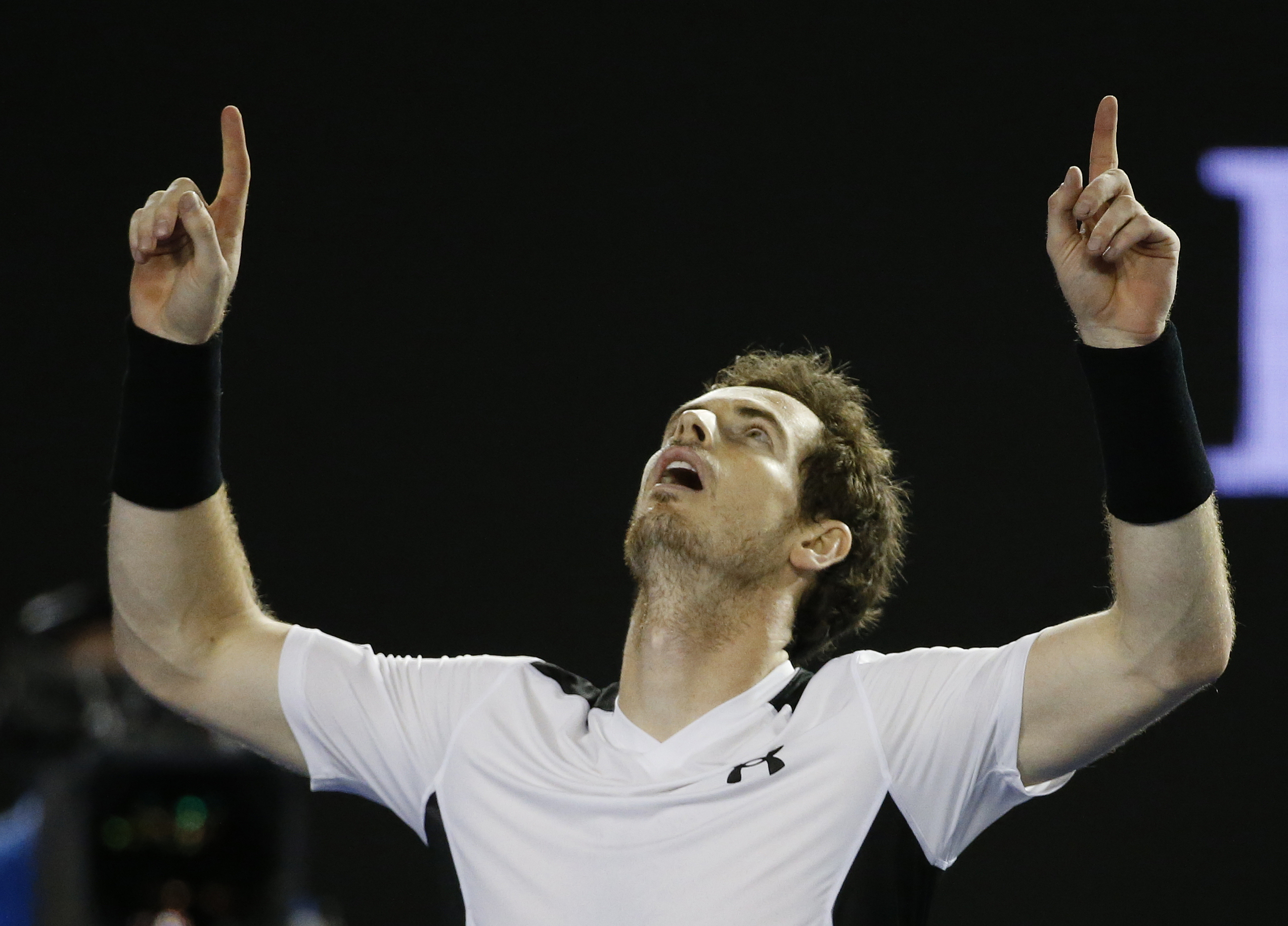 Andy Murray of Britain celebrates after defeating Milos Raonic of Canada in their semifinal match at the Australian Open tennis championships in Melbourne, Australia, Friday, Jan. 29, 2016.(AP Photo/Vincent Thian)