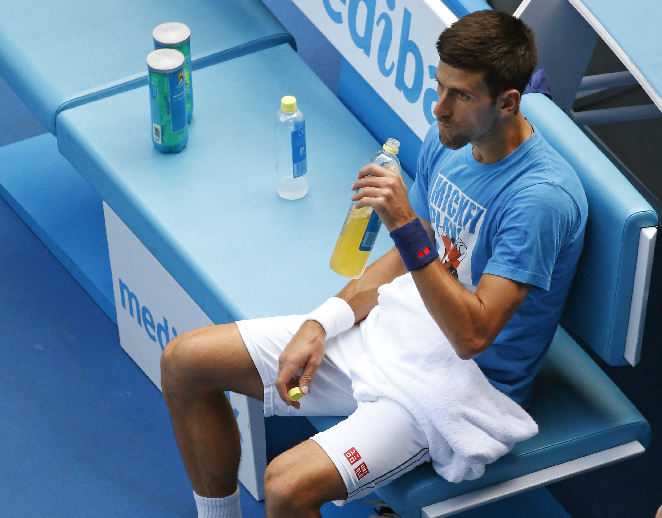Serbia's Novak Djokovic takes a drink during a practice session ahead of the men's singles final at the Australian Open tennis championships in Melbourne, Australia, Saturday, Jan. 30, 2016. Djokovic will play Britain's Andy Murray on Sunday Jan. 31. (AP