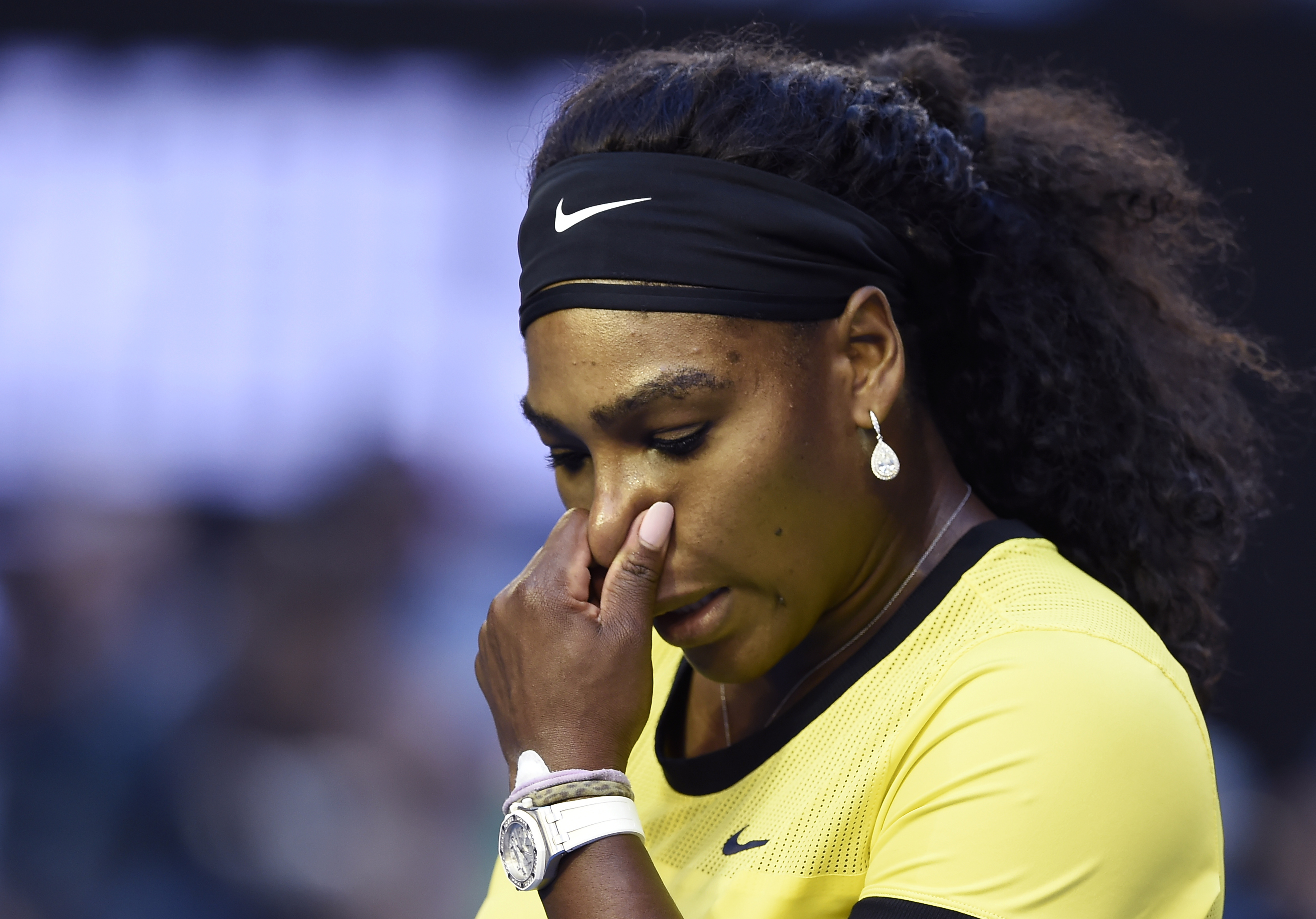 Serena Williams of the United States walks to her chair during a break in her women's singles final match against Angelique Kerber of Germany at the Australian Open tennis championships in Melbourne, Australia, Saturday, Jan. 30, 2016.(AP Photo/Andrew Bro