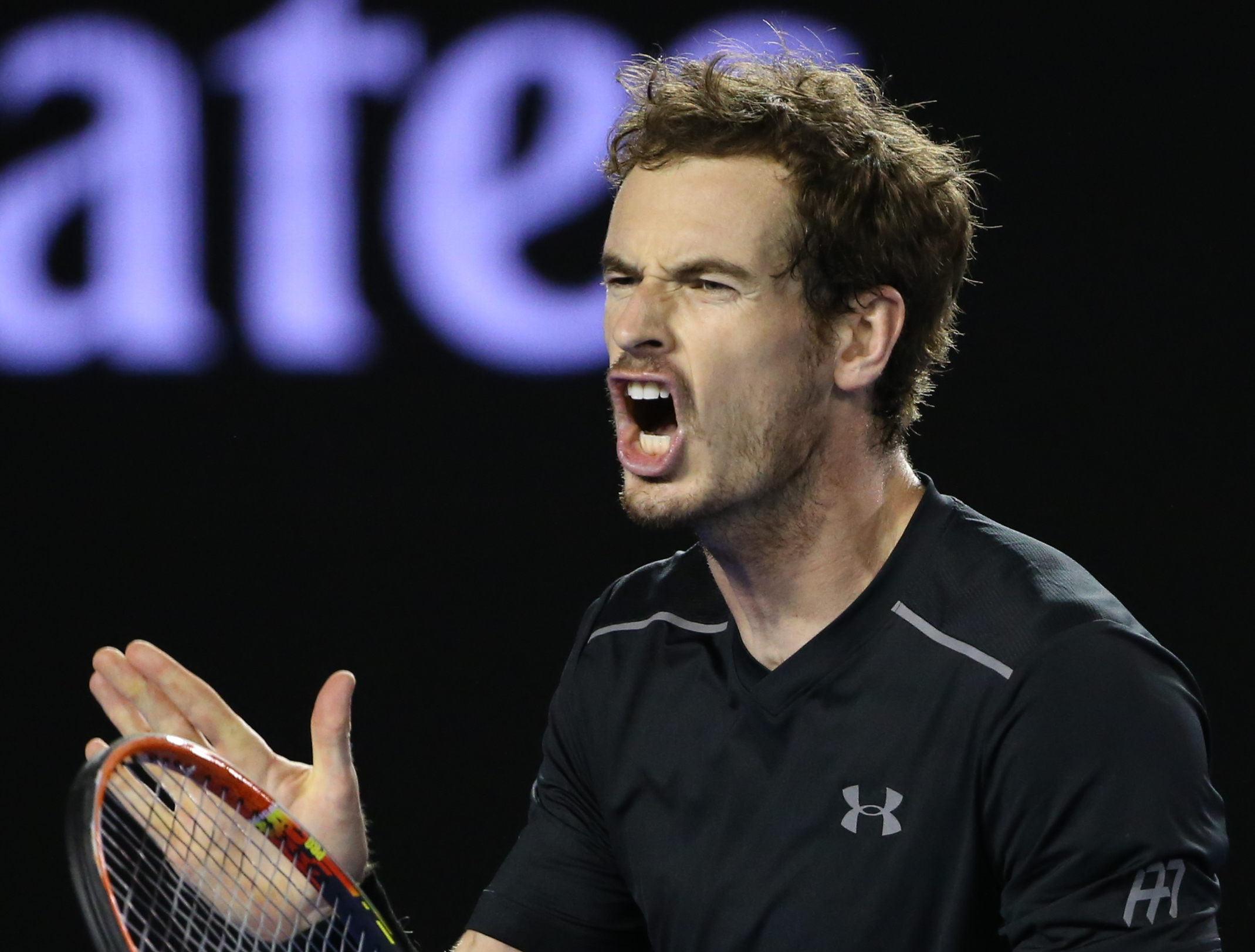 Andy Murray of Britain yells during his match against Novak Djokovic of Serbia in the men's singles final at the Australian Open tennis championships in Melbourne, Australia, Sunday, Jan. 31, 2016.(AP Photo/Rick Rycroft)