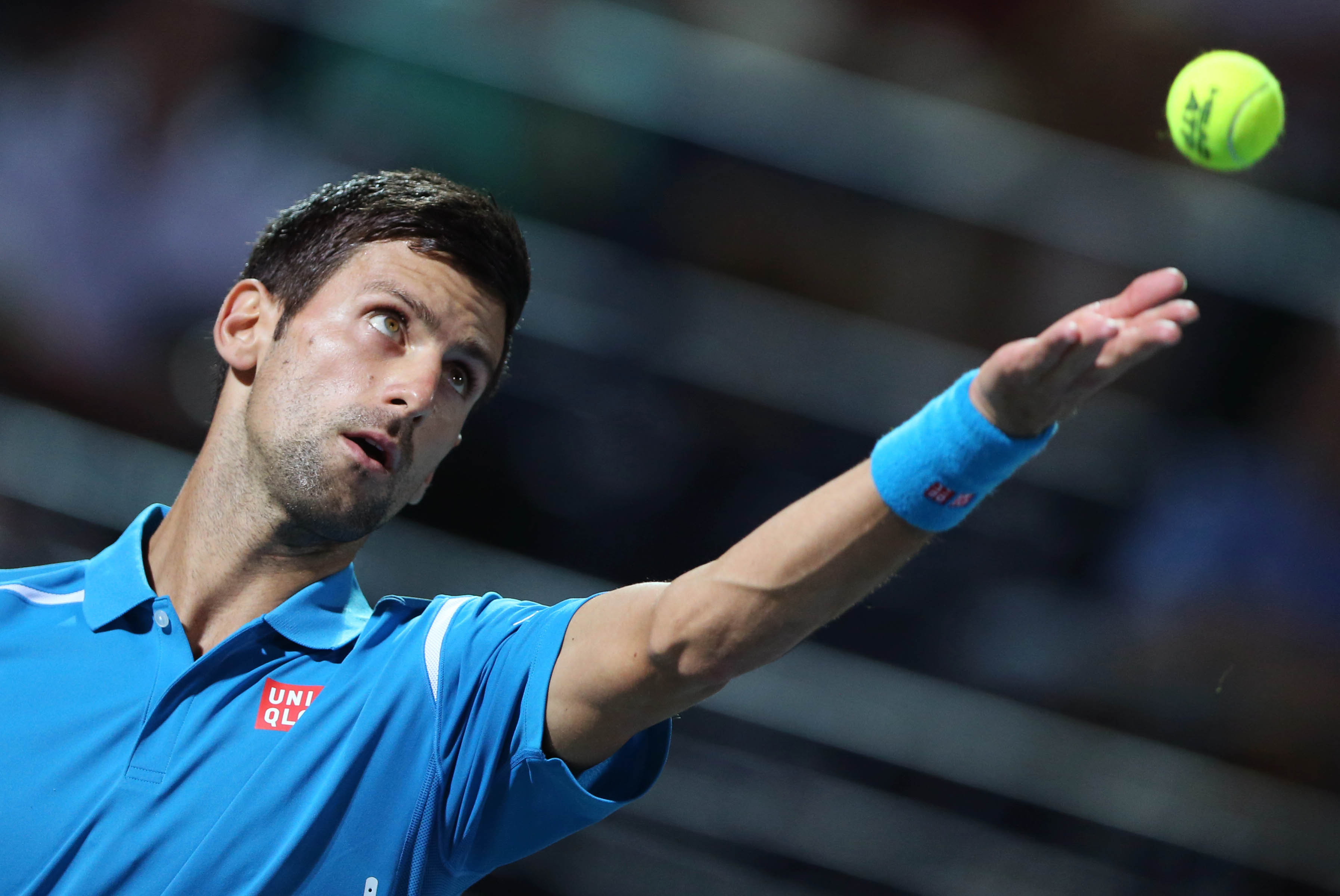 Novak Djokovic from Serbia serves the ball to Tommy Robredo from Spain during a first day match of the Dubai Tennis Championships in Dubai, United Arab Emirates, Monday, Feb. 22, 2016. (AP Photo/Kamran Jebreili)