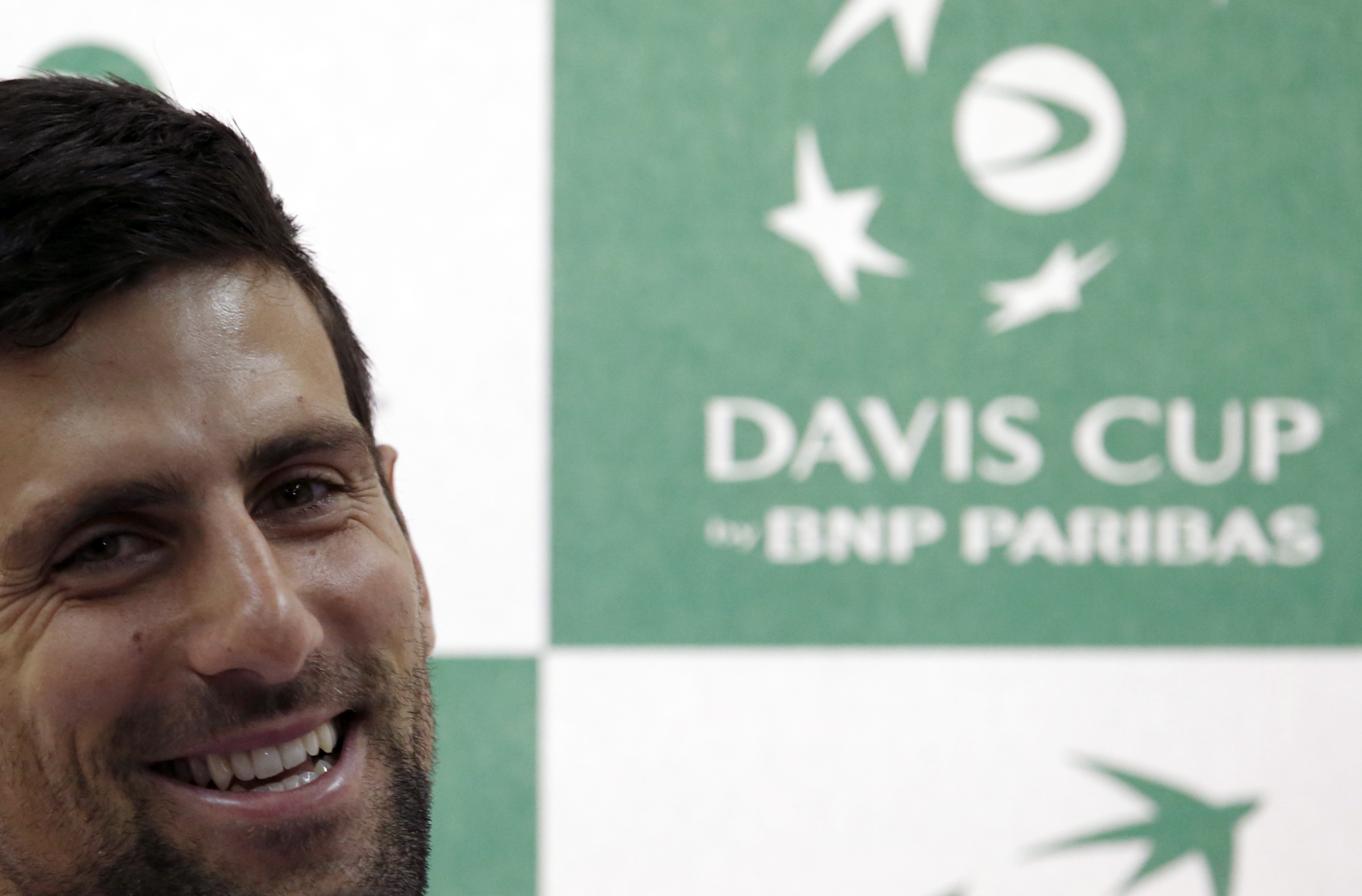 Serbian Davis Cup team player Novak Djokovic smiles during a press conference in Belgrade, Serbia, Wednesday, March 2, 2016. Serbia will play Kazakhstan in the Davis Cup World Group 1st Rrund starting on March 4-6, in Belgrade. (AP Photo/Darko Vojinovic)