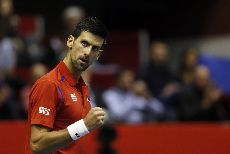 Novak Djokovic of Serbia reacts during their Davis Cup World Group first round tennis match against Kazakhstan's Aleksandr Nedovyesov, in Belgrade, Serbia, Friday, March 4, 2016. (AP Photo/Darko Vojinovic)