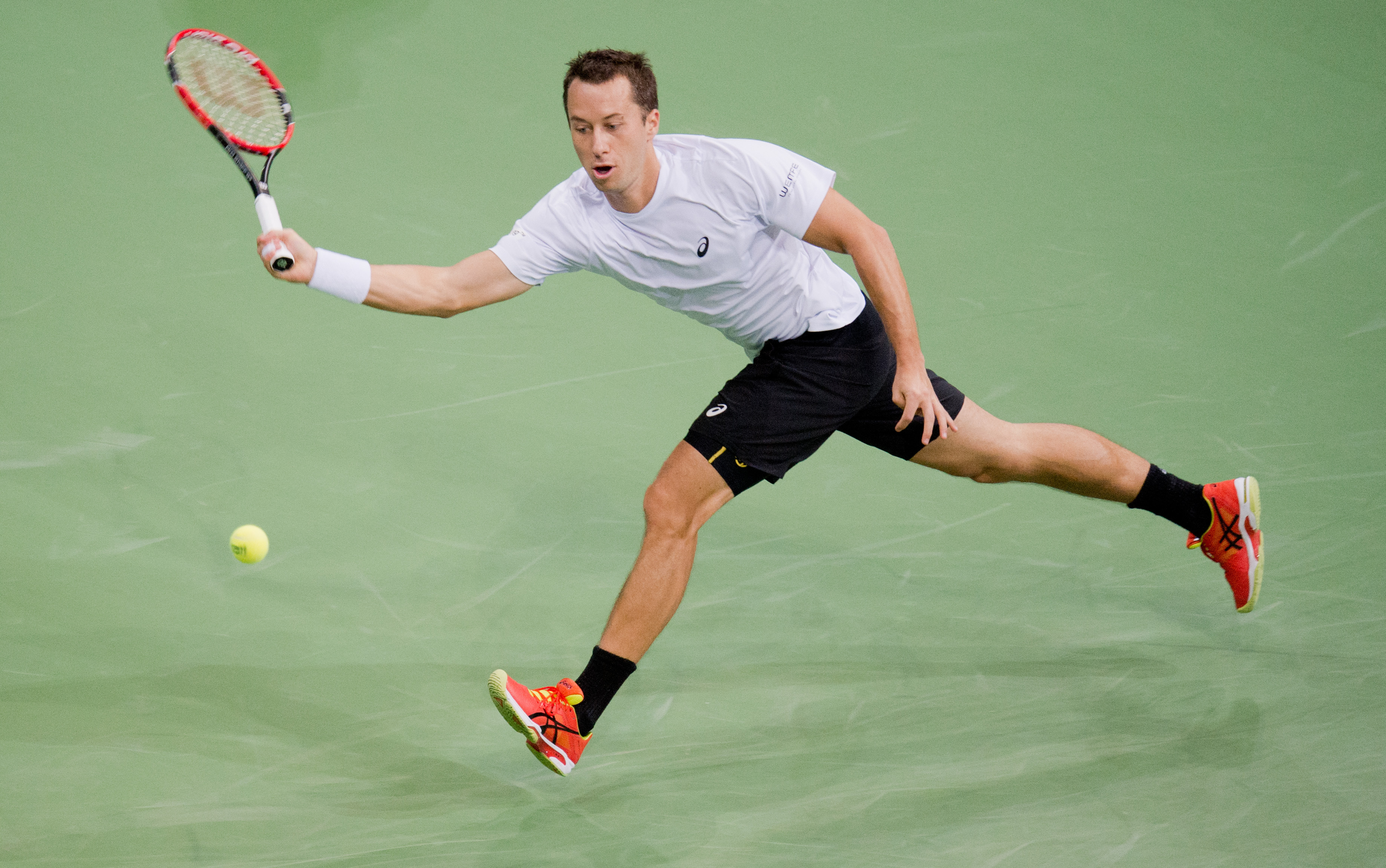 Germany's Philipp Kohlschreiber  returns a ball   during  his  match against Czech Republic's  Lukas Rosol at the World Group first round match  of the Davis Cup  in Hannover, Germany,  Friday March 4, 2016.  (Julian Stratenschulte/dpa via AP)
