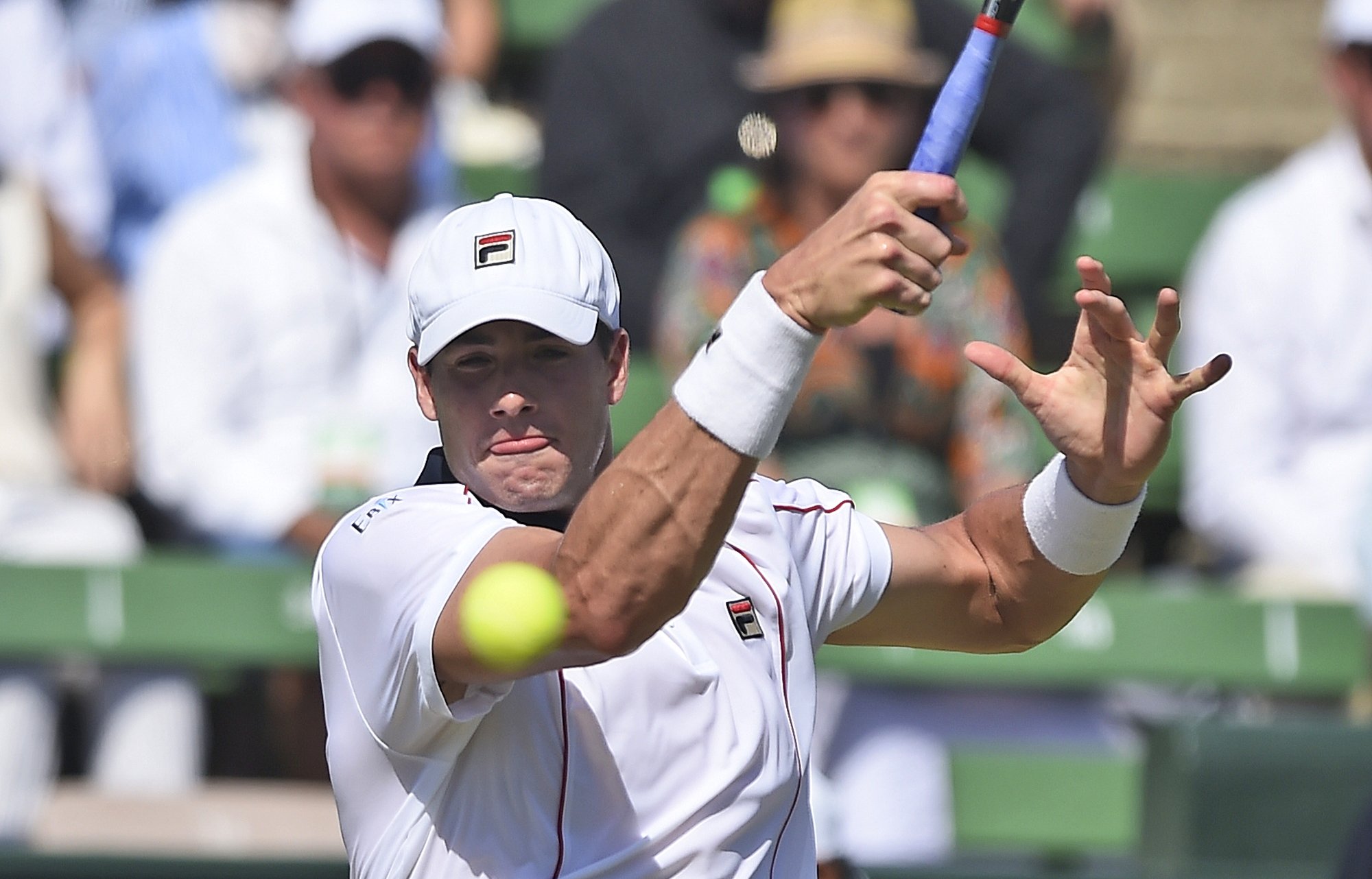 John Isner of the United States plays a forehand shot to Australia's Bernard Tomic during their Davis Cup singles match in Melbourne, Australia, Sunday, March 6, 2016. (AP Photo/Andrew Brownbill)