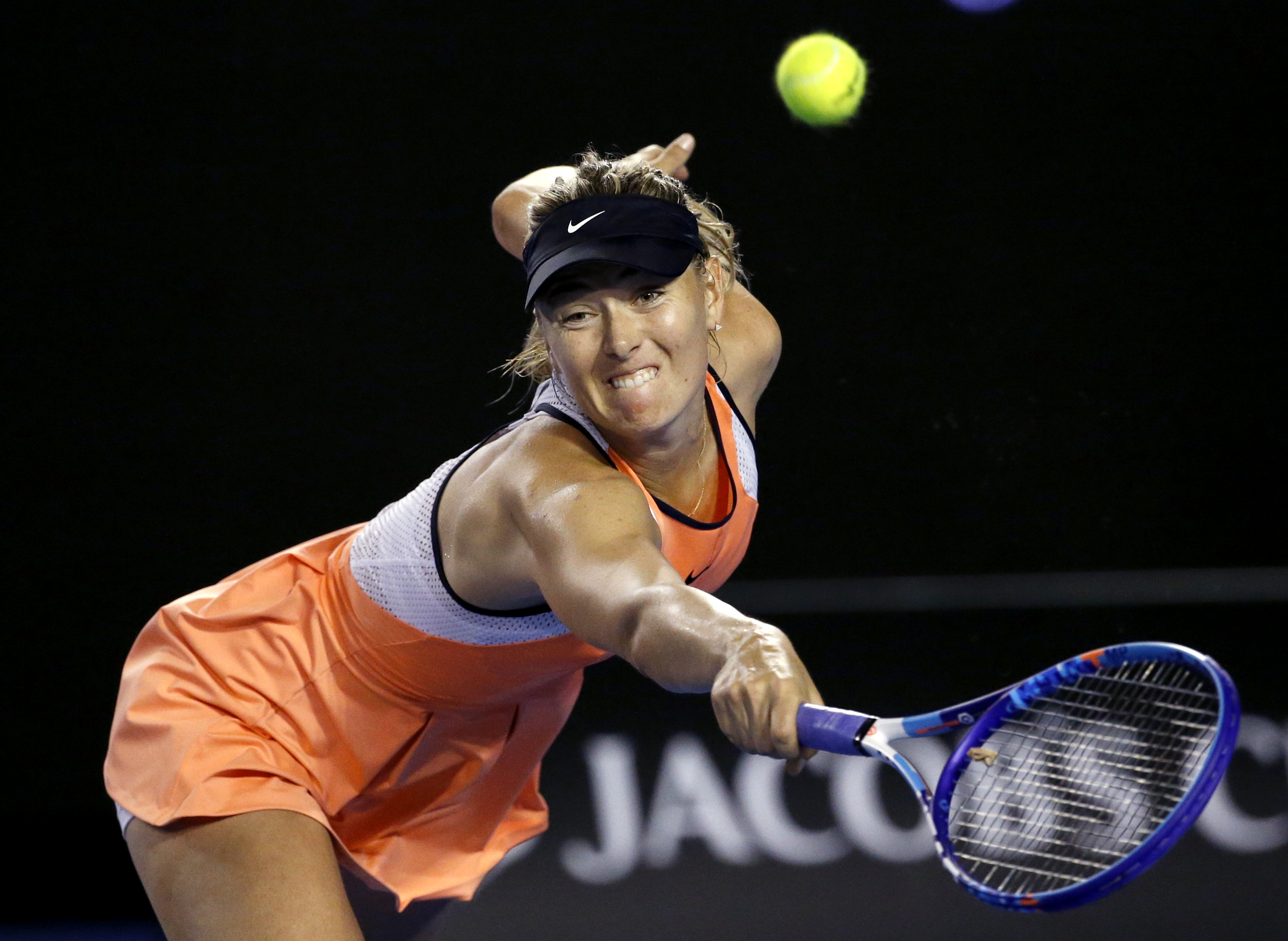 FILE - In this Jan. 20, 2016, file photo, Maria Sharapova of Russia reaches for a backhand return to Aliaksandra Sasnovich of Belarus during their second round match at the Australian Open tennis championships in Melbourne, Australia. Sharapova has called