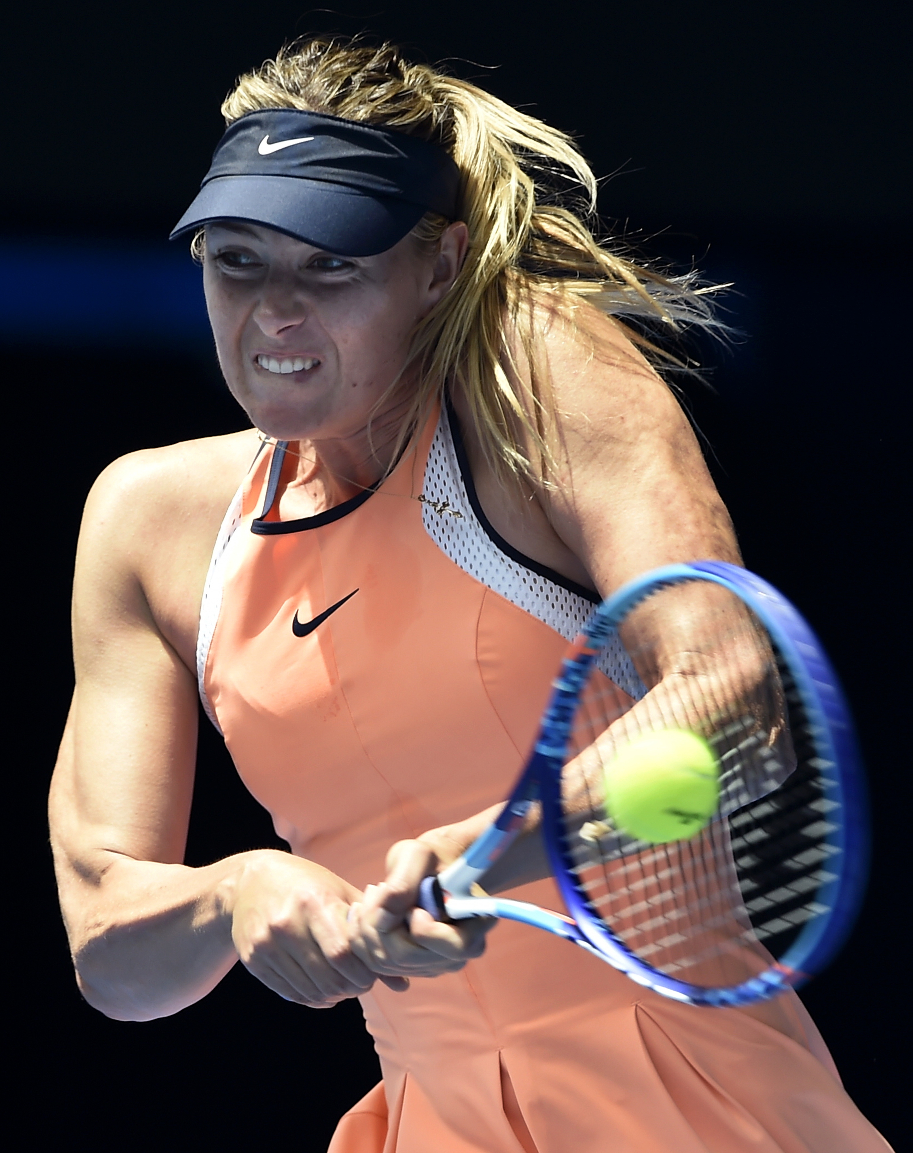 FILE - In this Tuesday, Jan.  26, 2016, file photo, Maria Sharapova of Russia plays a backhand return to Serena Williams of the United States during their quarterfinal match at the Australian Open tennis championships in Melbourne, Australia. The five-tim