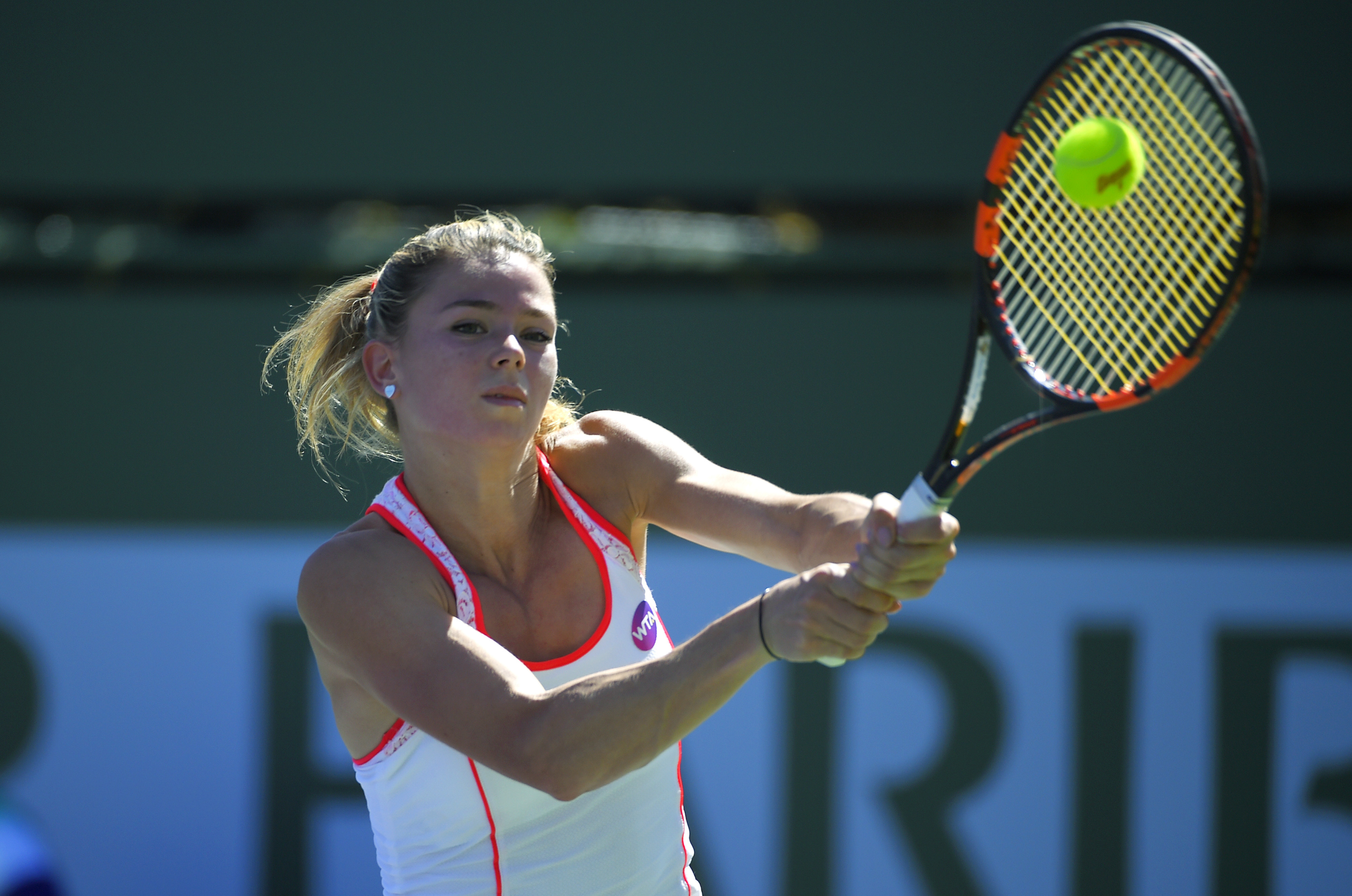 Camila Giorgi, of Italy, returns to Julia Goerges, of Germany, during their match at the BNP Paribas Open tennis tournament, Thursday, March 10, 2016, in Indian Wells, Calif. (AP Photo/Mark J. Terrill)