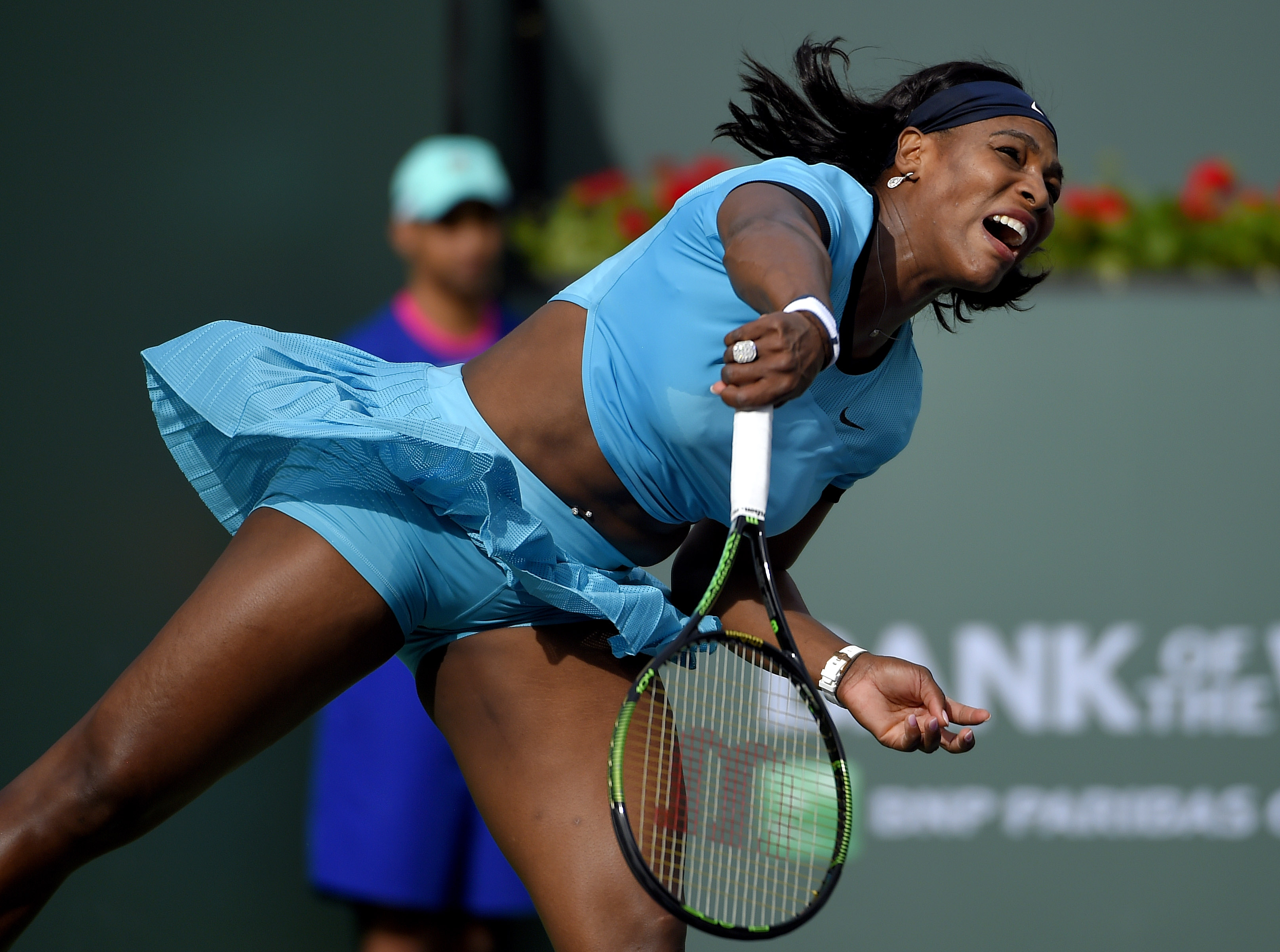 Serena Williams serves to Yulia Putintseva during their match at the BNP Paribas Open tennis tournament, Sunday, March 13, 2016, in Indian Wells, Calif. (AP Photo/Mark J. Terrill)