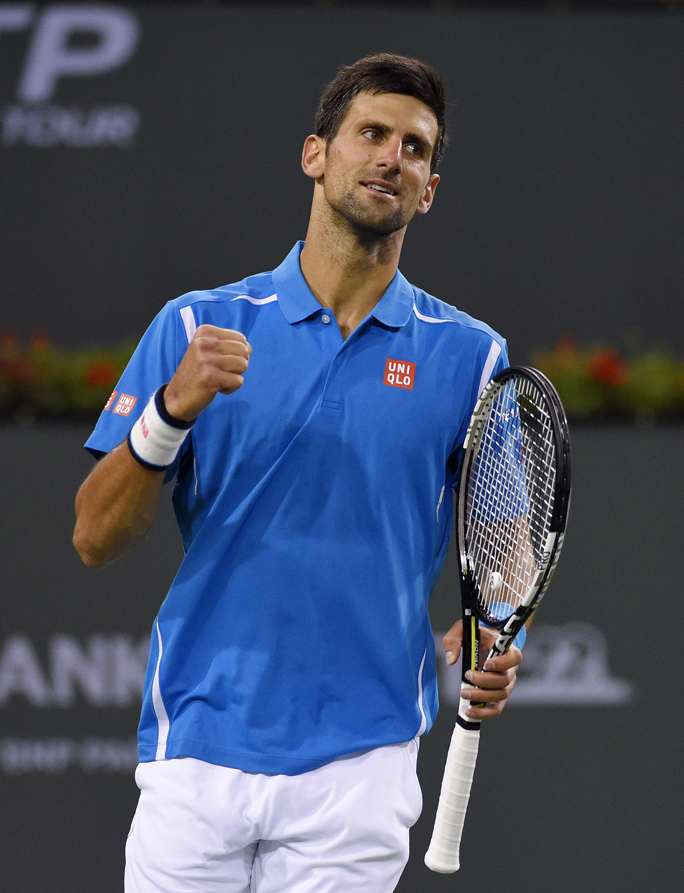 Novak Djokovic, of Serbia, celebrates after defeating Feliciano Lopez, of Spain, 6-3, 6-3 at the BNP Paribas Open tennis tournament, Wednesday, March 16, 2016, in Indian Wells, Calif. (AP Photo/Mark J. Terrill)