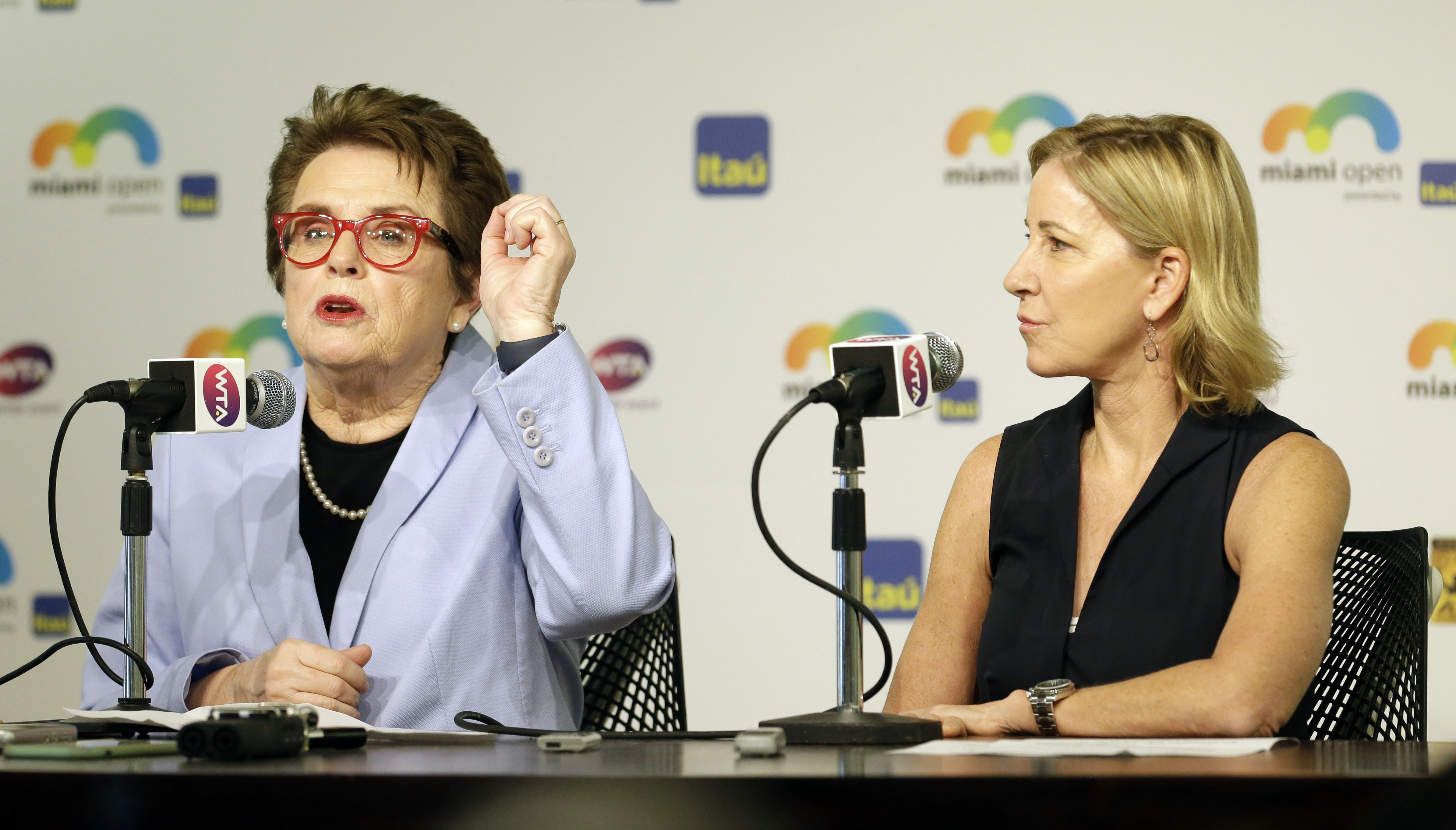 Billie Jean King, left, gestures as she talks to reporters as Chris Evert, right, looks on, at the Miami Open tennis match, in Key Biscayne, Fla., Wednesday, March 23, 2016. King and Evert talked about the resignation of the tournament director of the BNP