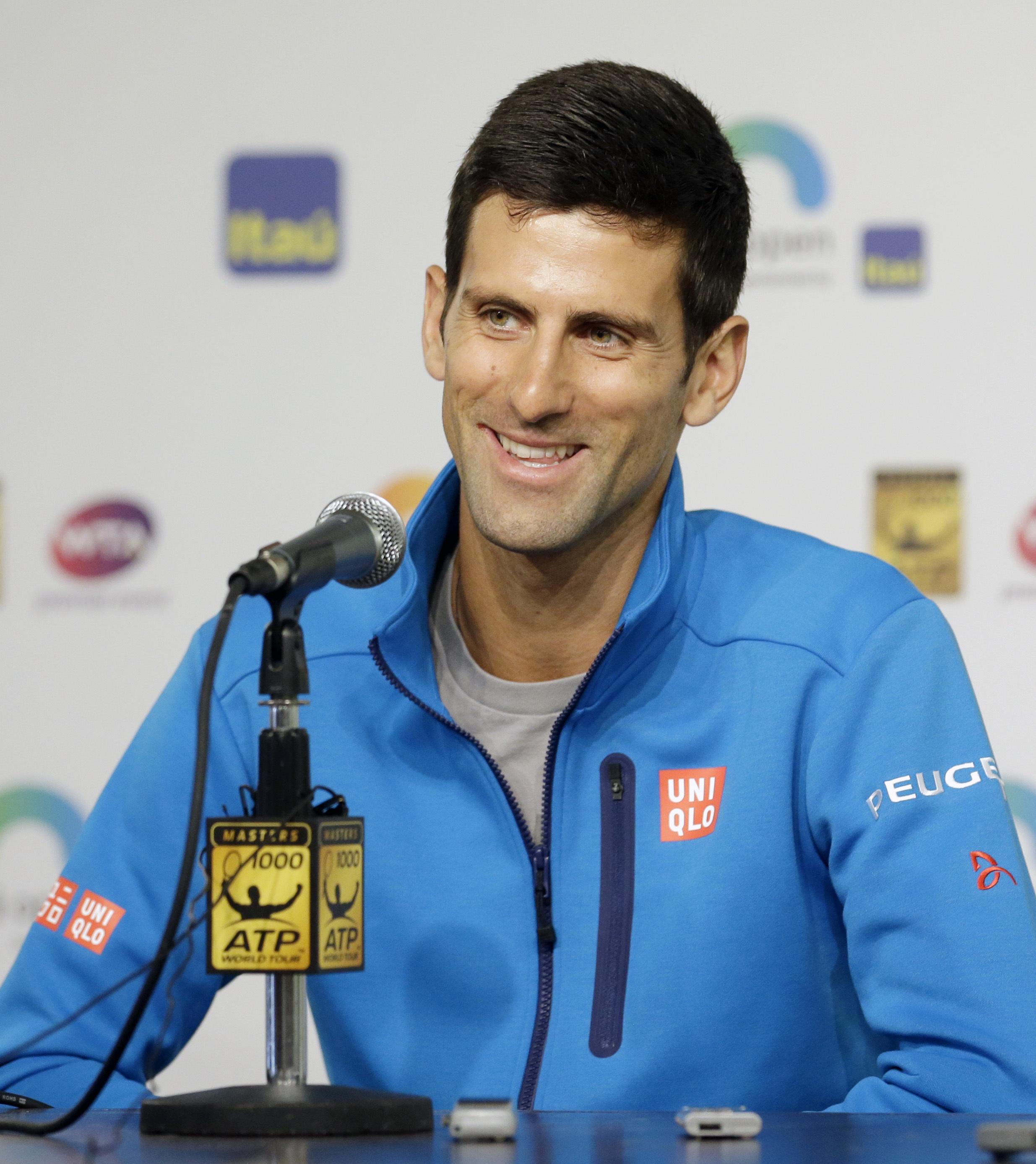 Novak Djokovic, of Serbia, talks to reporters at the Miami Open tennis tournament in Key Biscayne, Fla., Wednesday, March 23, 2016. (AP Photo/Alan Diaz)