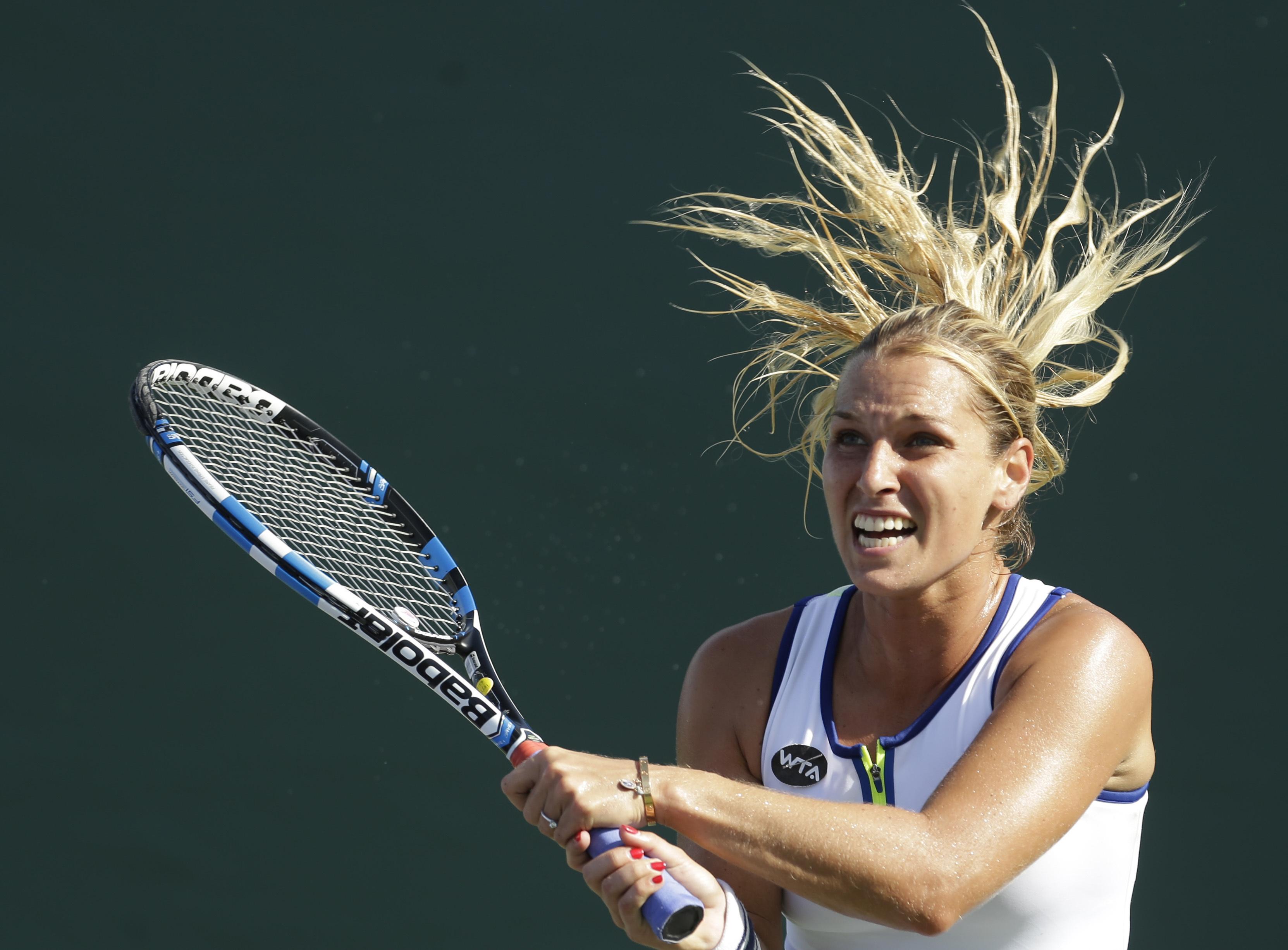Dominika Cibulkova, of Slovakia, returns to Johanna Larsson, of Sweden, during a match at the Miami Open tennis tournament in Key Biscayne, Fla., Wednesday, March 23, 2016. Cibulkova won 4-6, 6-1, 6-2. (AP Photo/Alan Diaz)