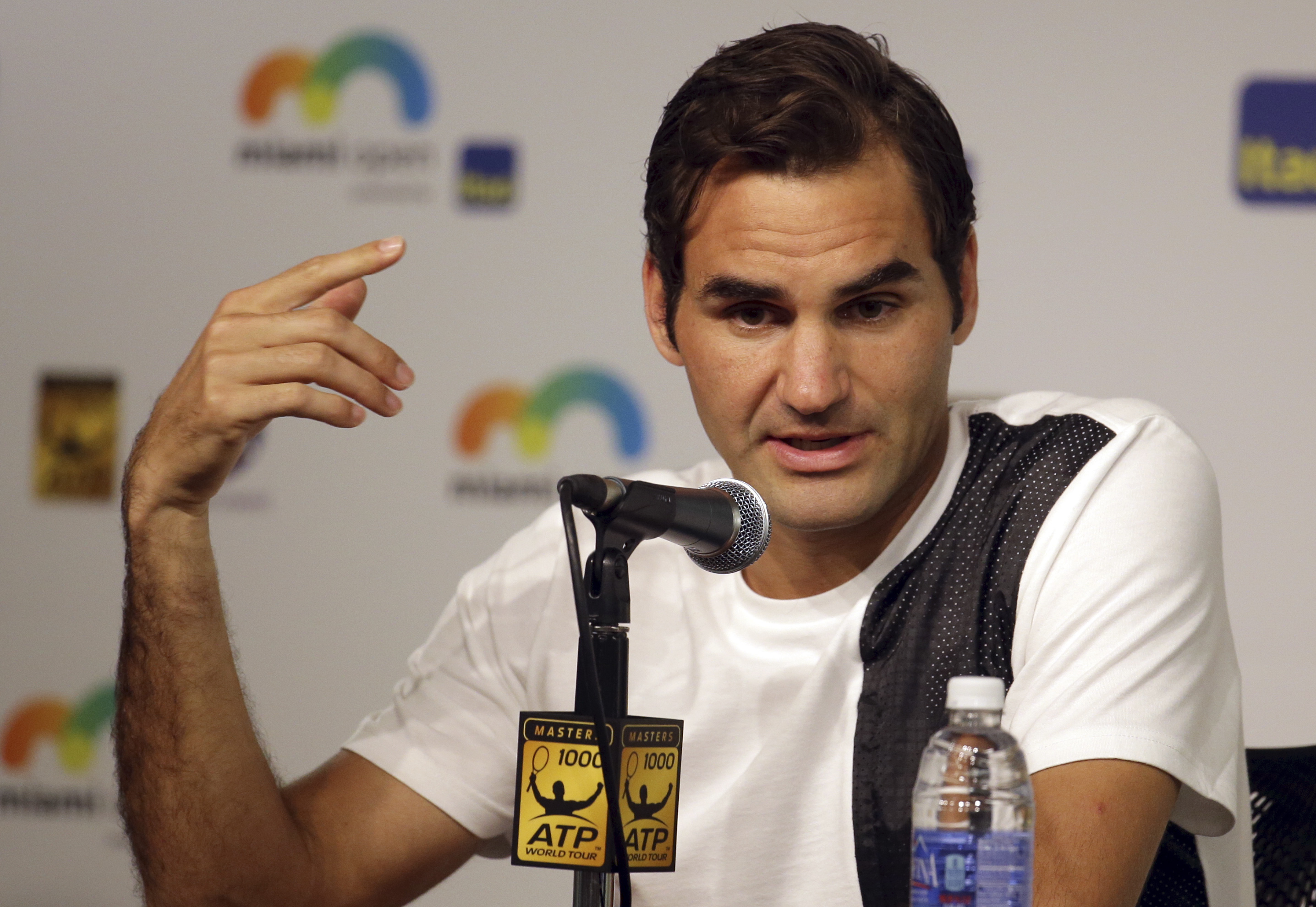Roger Federer, of Switzerland, responds to a question during a news conference at the Miami Open tennis tournament, Thursday, March 24, 2016, in Key Biscayne, Fla. This is Federer's first tournament since recovering from knee surgery. (AP Photo/Lynne Slad