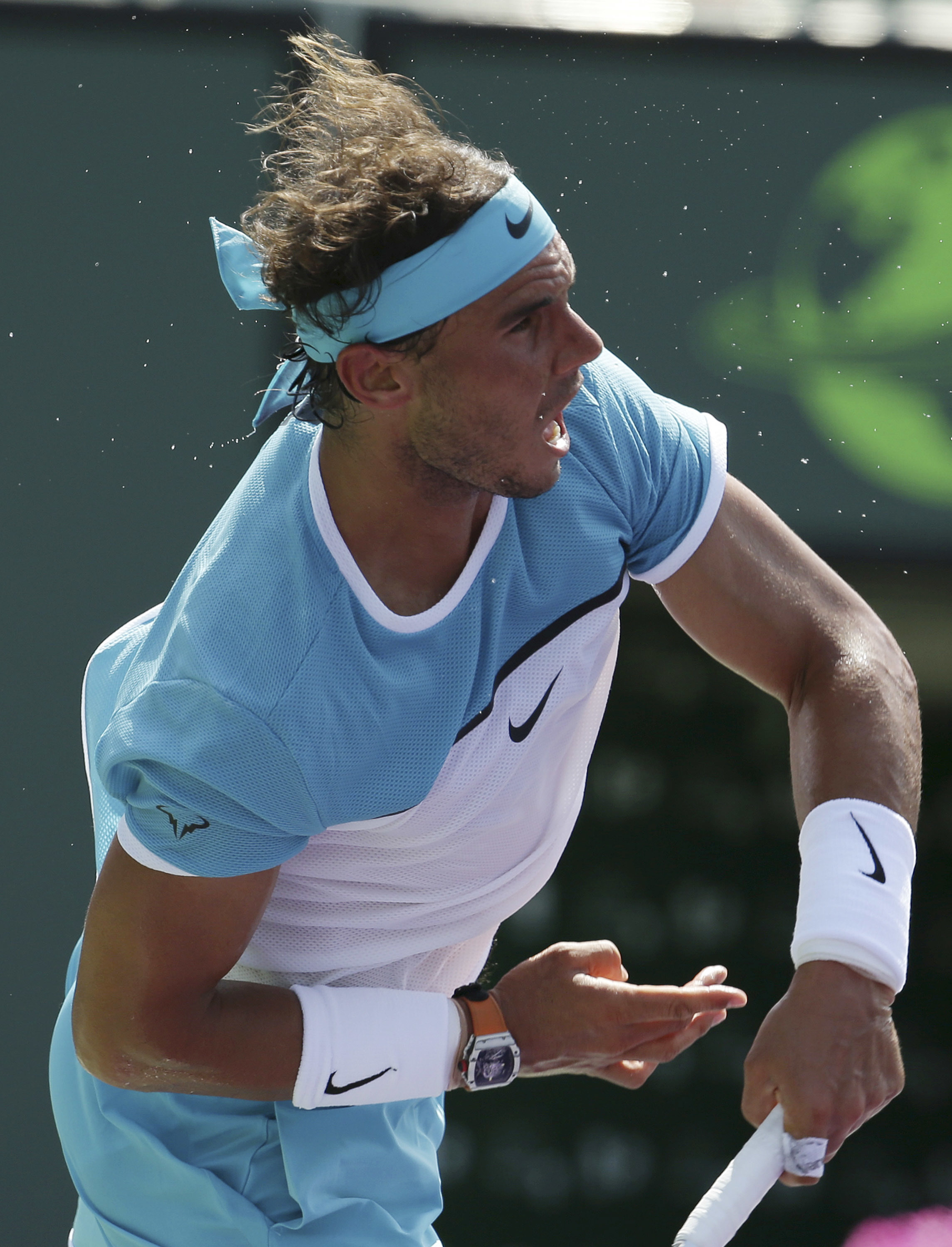 Rafael Nadal, of Spain, serves to Damir Dzumhur during their match at the Miami Open tennis tournament, Saturday, March 26, 2016, in Key Biscayne, Fla. (AP Photo/Lynne Sladkyhttp://uploaded.net/file/7ppbusl9/documentary.su-Hunting.Hitler.Series.1.1of8.The