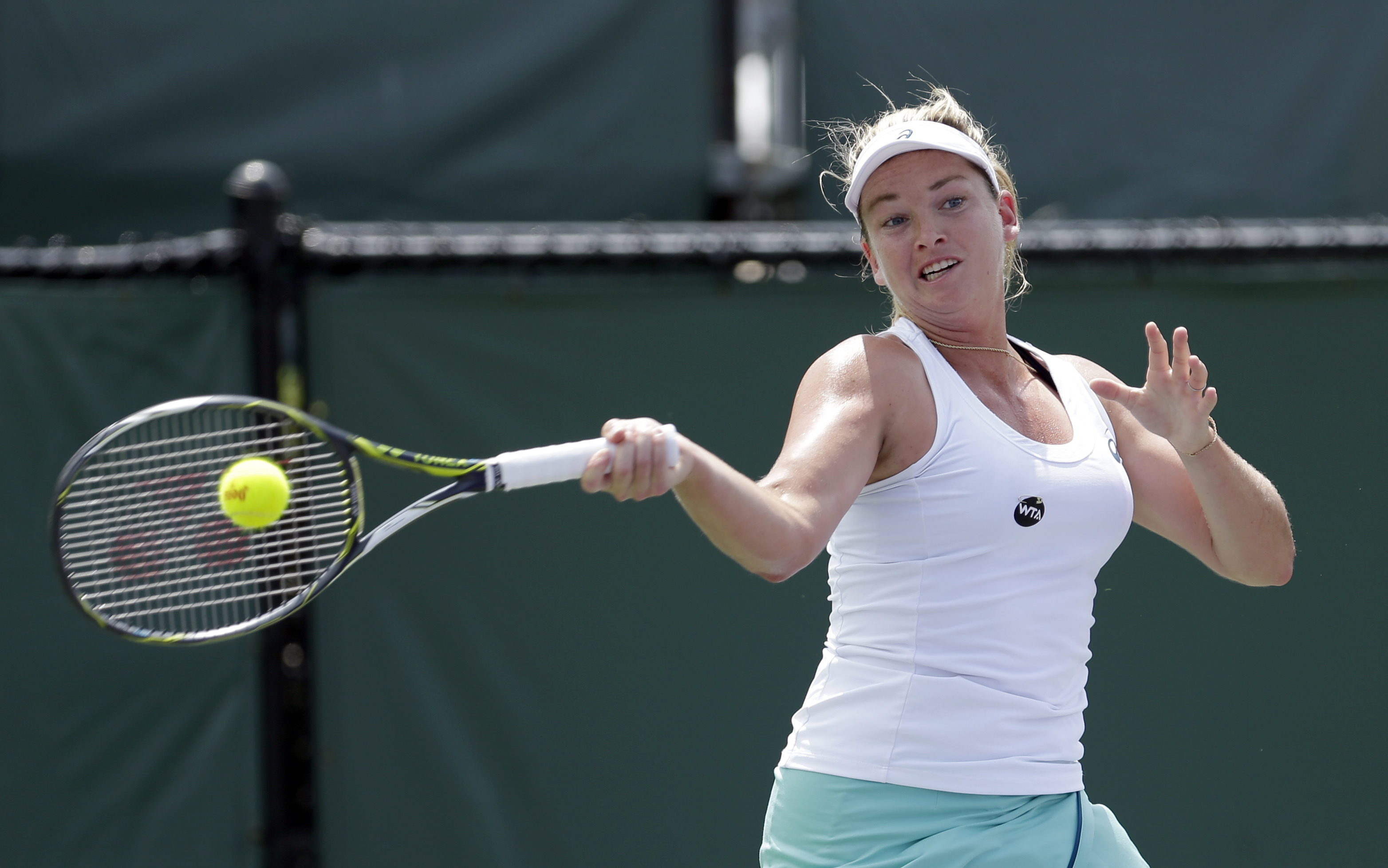 Coco Vandeweghe, of the United States, returns to Monica Niculescu during the Miami Open tennis tournament in Key Biscayne, Fla., Sunday, March 27, 2016. (AP Photo/Alan Diaz)