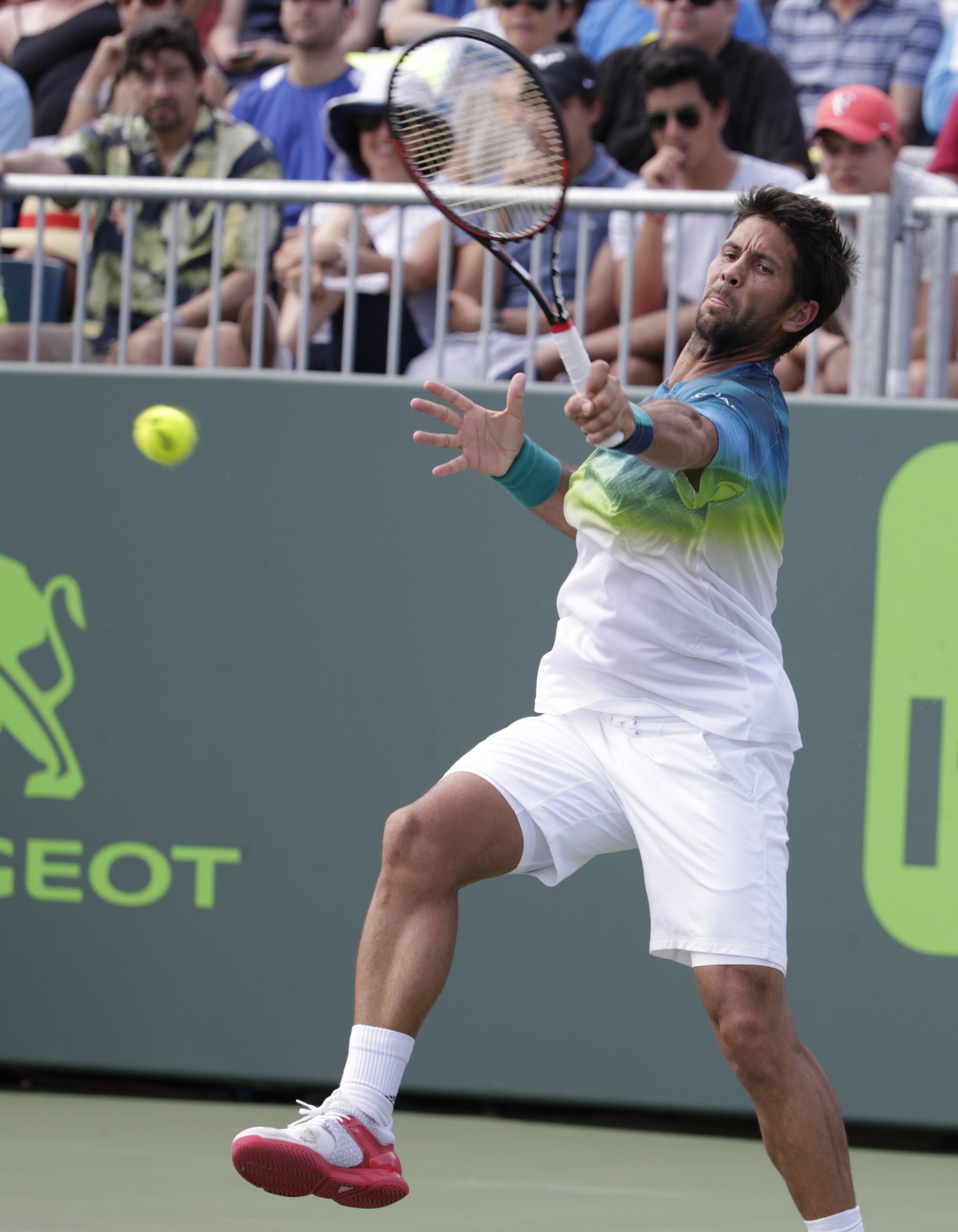 Fernando Verdasco, of Spain, returns to Horacio Zeballos during their match at the Miami Open tennis tournament, Sunday, March 27, 2016, in Key Biscayne, Fla. Zeballos won the match 1-6, 6-4, 7-6 (4). (AP Photo/Lynne Sladky)