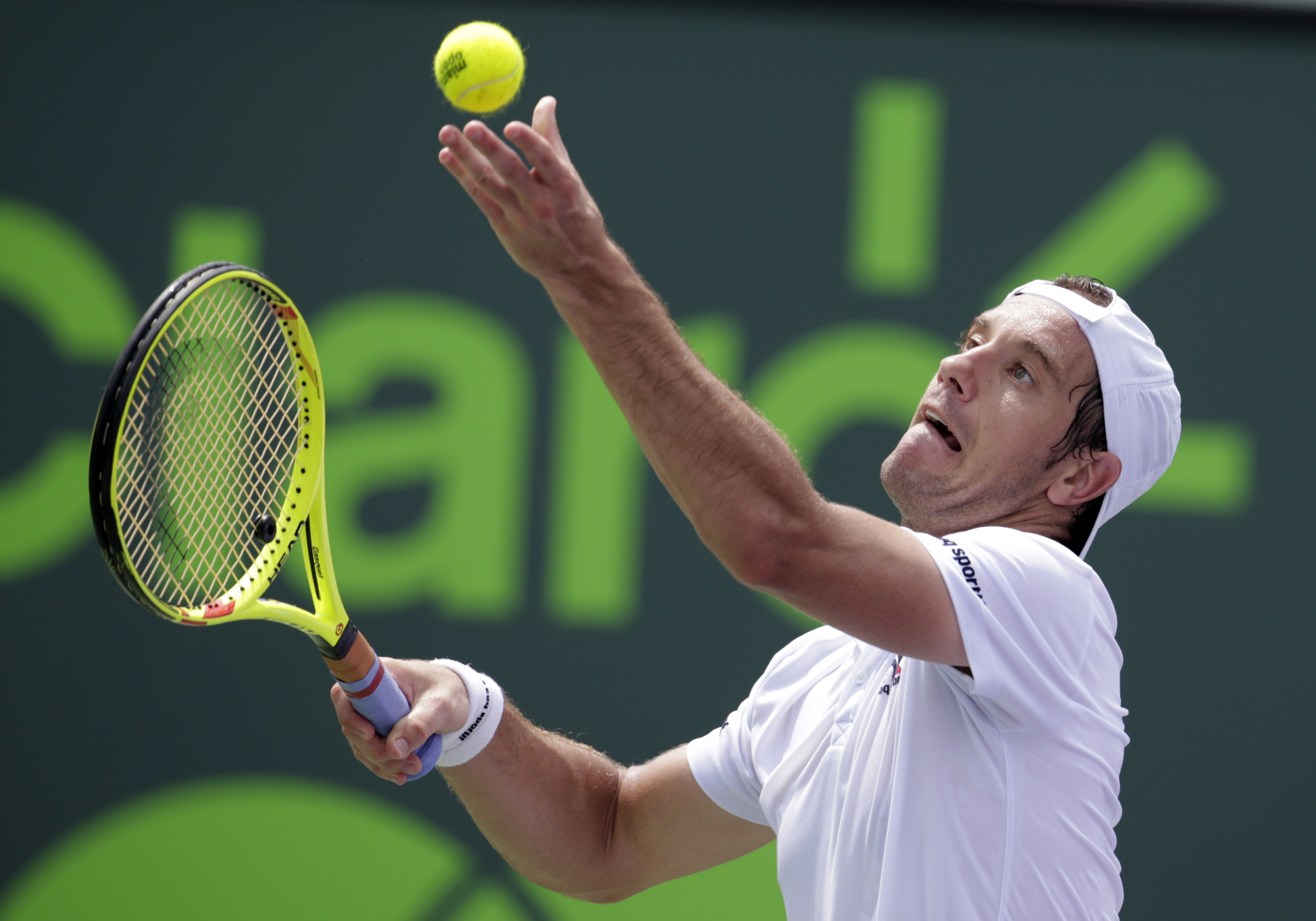 Richard Gasquet, of France, serves to Tomas Berdych during their match at the Miami Open tennis tournament, Tuesday, March 29, 2016, in Key Biscayne, Fla. Berdych won 6-4, 3-6, 7-5. (AP Photo/Lynne Sladky)