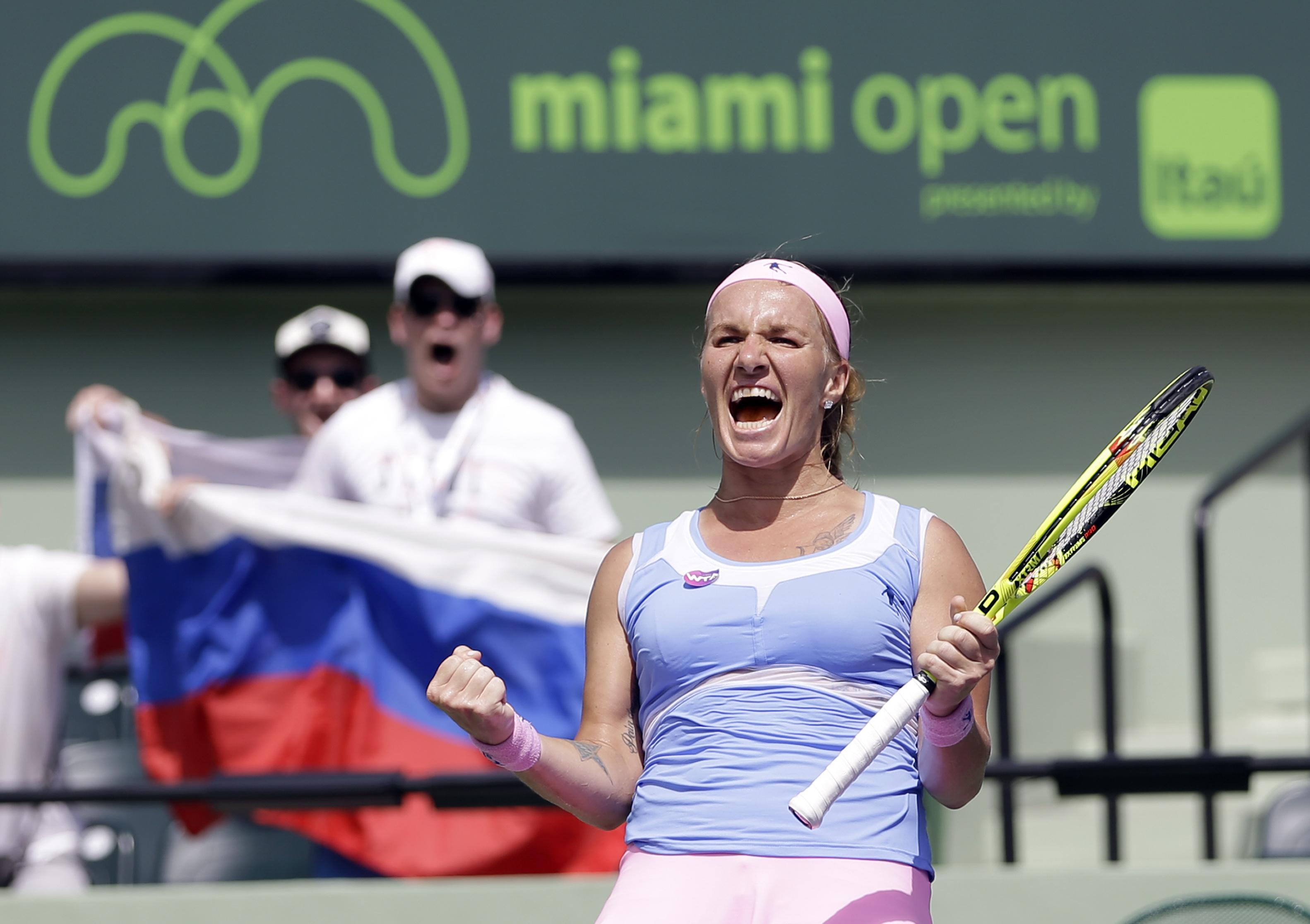 Svetlana Kuznetsova, of Russia, celebrates after winning 7-5, 6-3, against Timea Bacsinszky, of Switzerland, during the Miami Open tennis tournament in Key Biscayne, Fla., Thursday, March 31, 2016. (AP Photo/Alan Diaz)