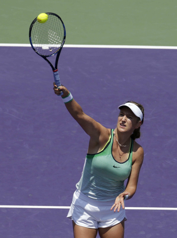 Victoria Azarenka, of Belarus, hits an overhead shot to Svetlana Kuznetsova during the women's singles final match at the Miami Open tennis tournament, Saturday, April 2, 2016, in Key Biscayne, Fla. (AP Photo/Lynne Sladky)