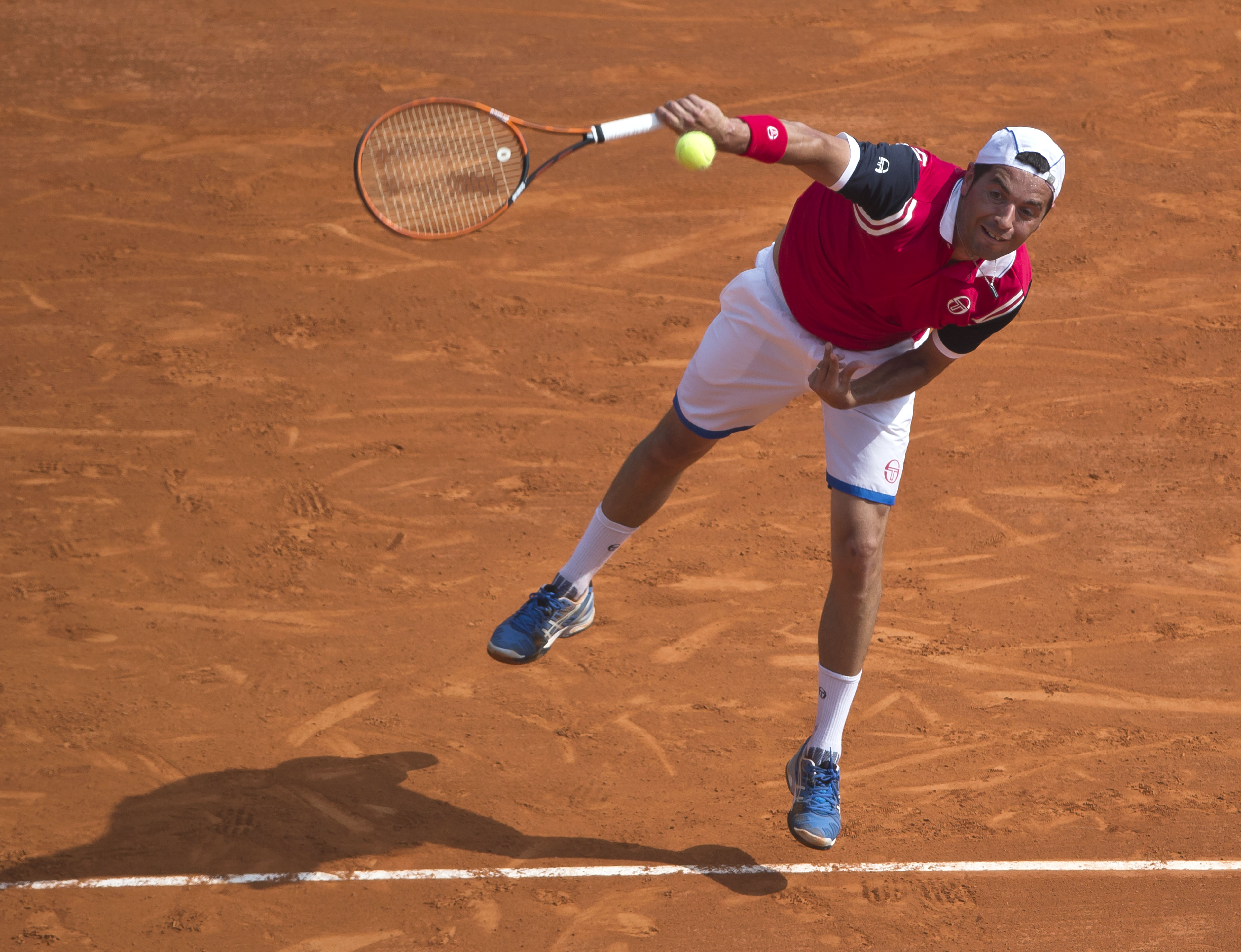 Albert Montanes of Spain serves the ball to Novak Djokovic of Serbia  during their match of the Monte Carlo Tennis Masters tournament in Monaco, Tuesday, April 15, 2014. (AP Photo/Michel Euler)