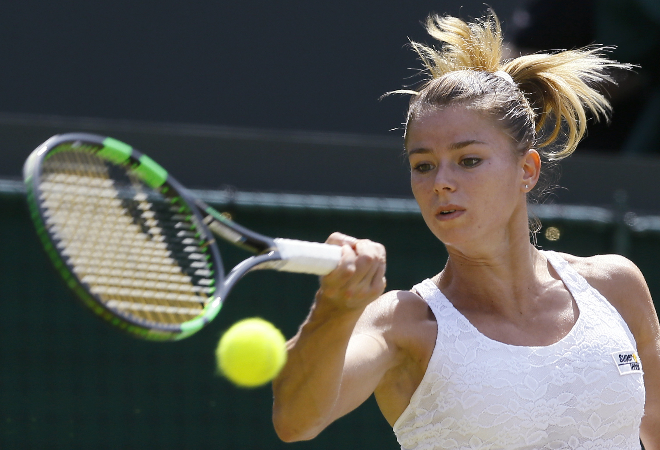 FILE -- In this July 4, 2015 file photo, Camila Giorgi of Italy plays a return to Caroline Wozniacki of Denmark during their singles match at the All England Lawn Tennis Championships in Wimbledon, London. Giorgi has turned down a call up to Italy's Fed C
