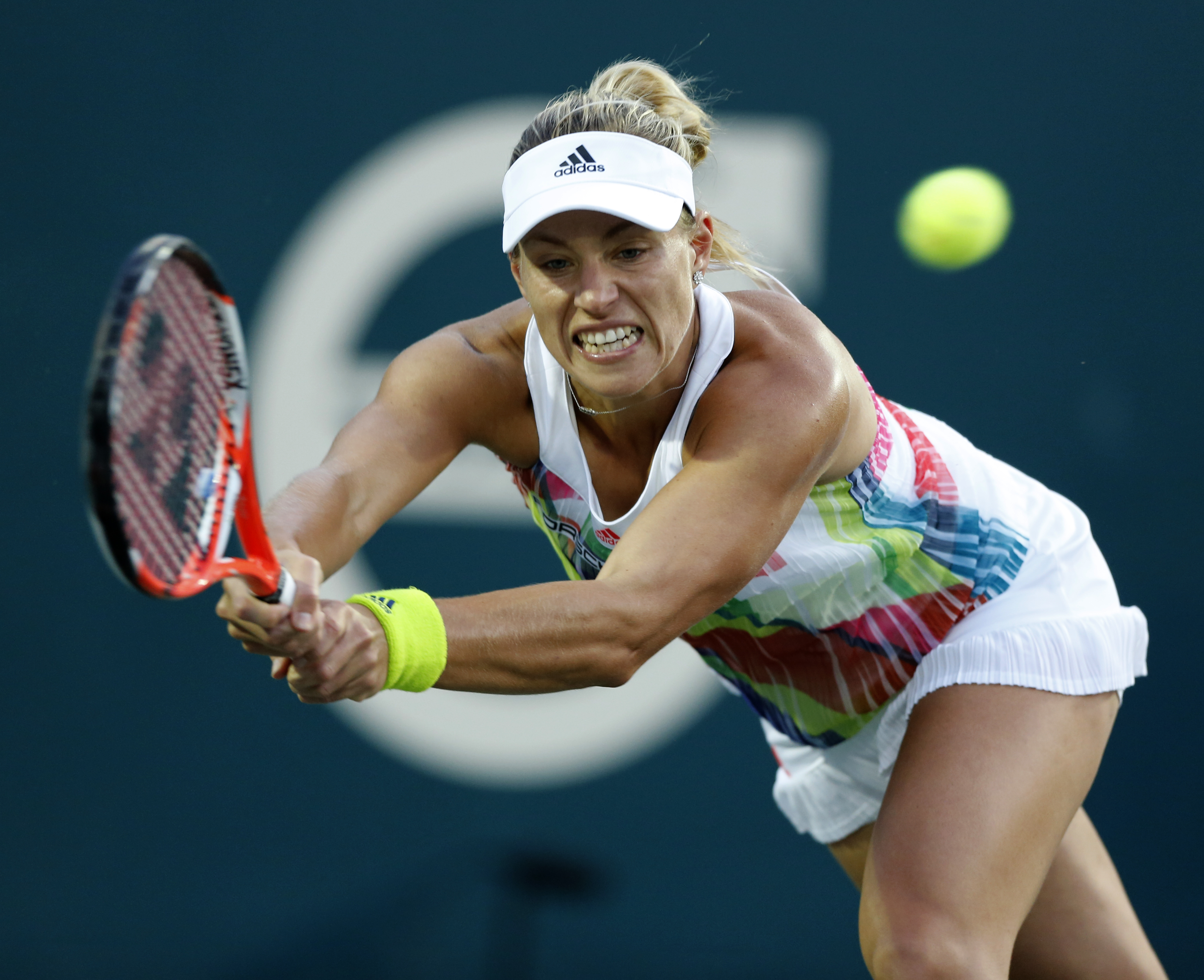 RETRANSMISSION TO CORRECT ID TO LARA ARRUABARRENA- Angelique Kerber, from Germany, returns a shot to Lara Arruabarrena, of Spain, during their tennis match at the Volvo Car Open in Charleston, S.C., Tuesday, April 5, 2016. (AP Photo/Mic Smith)
