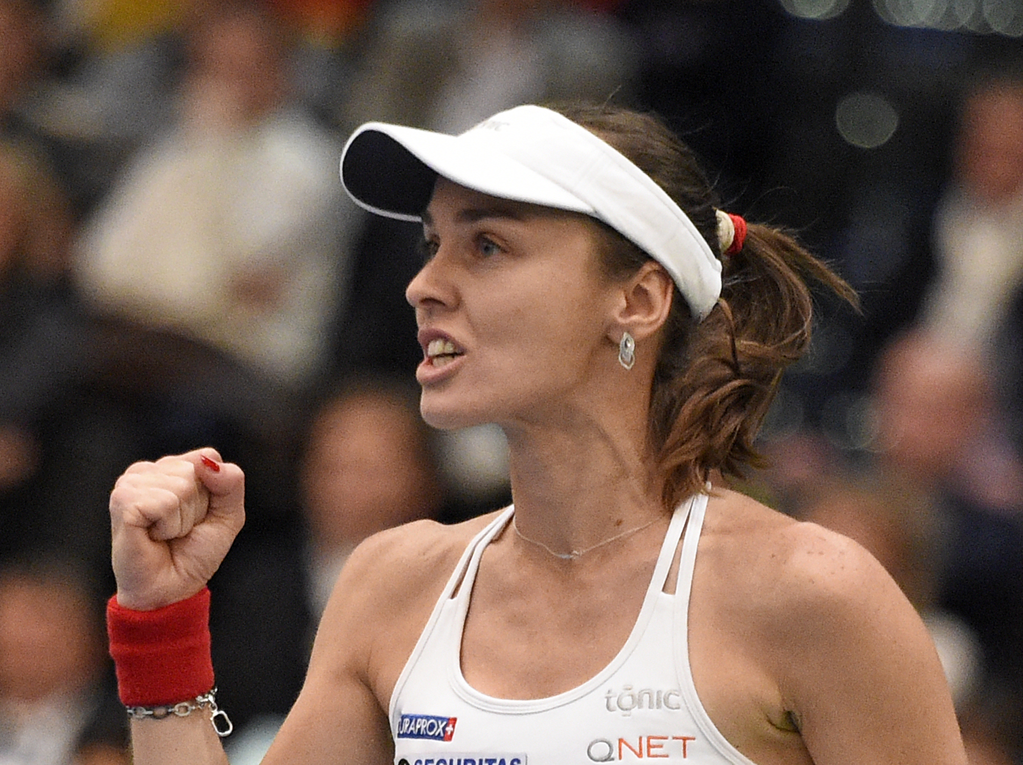 Martina Hingis of Switzerland celebrates a point in her doubles match during the Fed Cup World Group first round tennis match between Germany and Switzerland at the Leipzig Fair in Leipzig, Germany, Sunday, Feb. 7, 2016. (AP Photo/Jens Meyer)