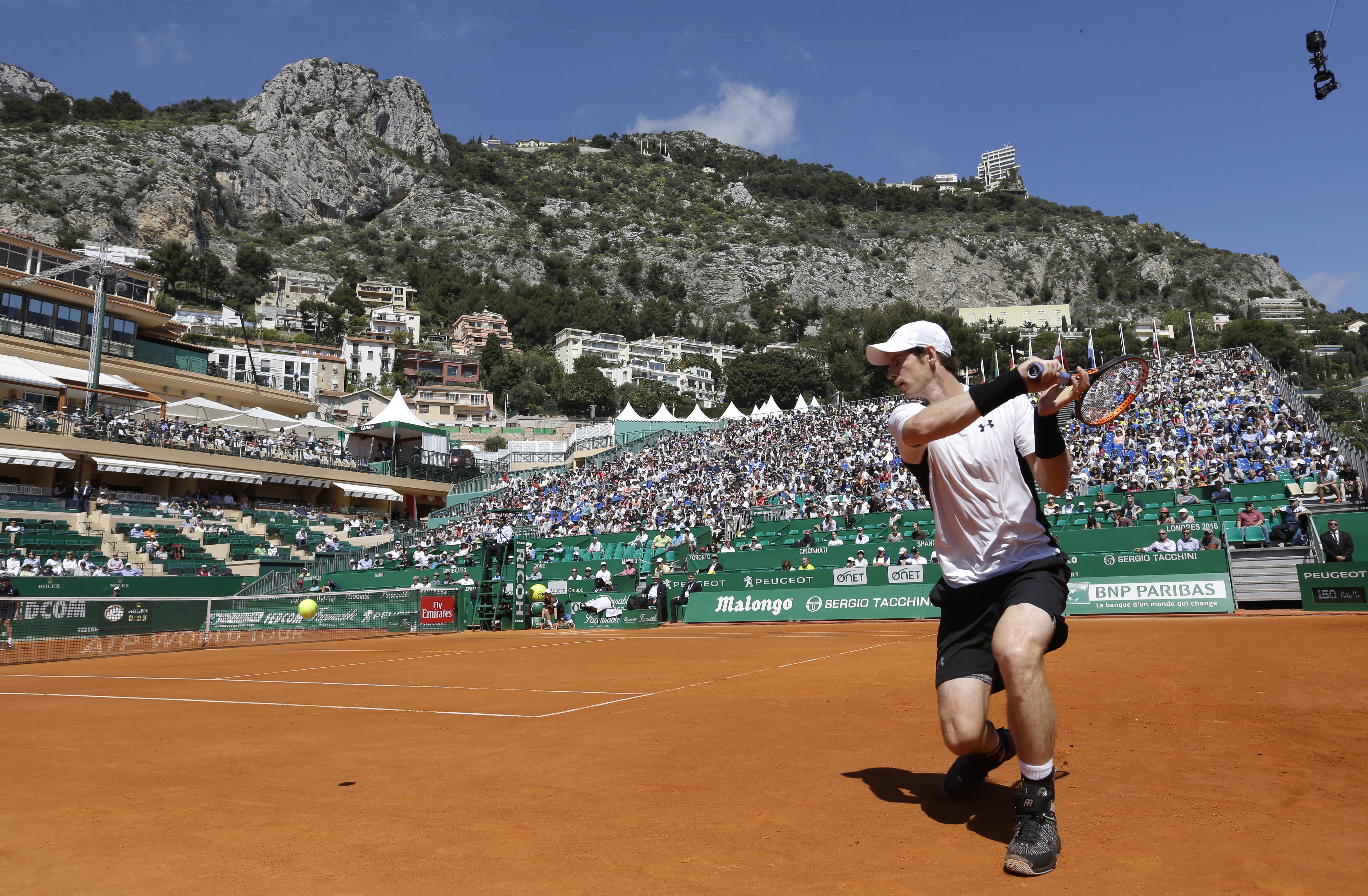 Britain's Andy Murray  plays a return to Pierre Hugues Herbert of France during their match of the Monte Carlo Tennis Masters tournament in Monaco, Tuesday, April 12, 2016. (AP Photo/Lionel Cironneau)