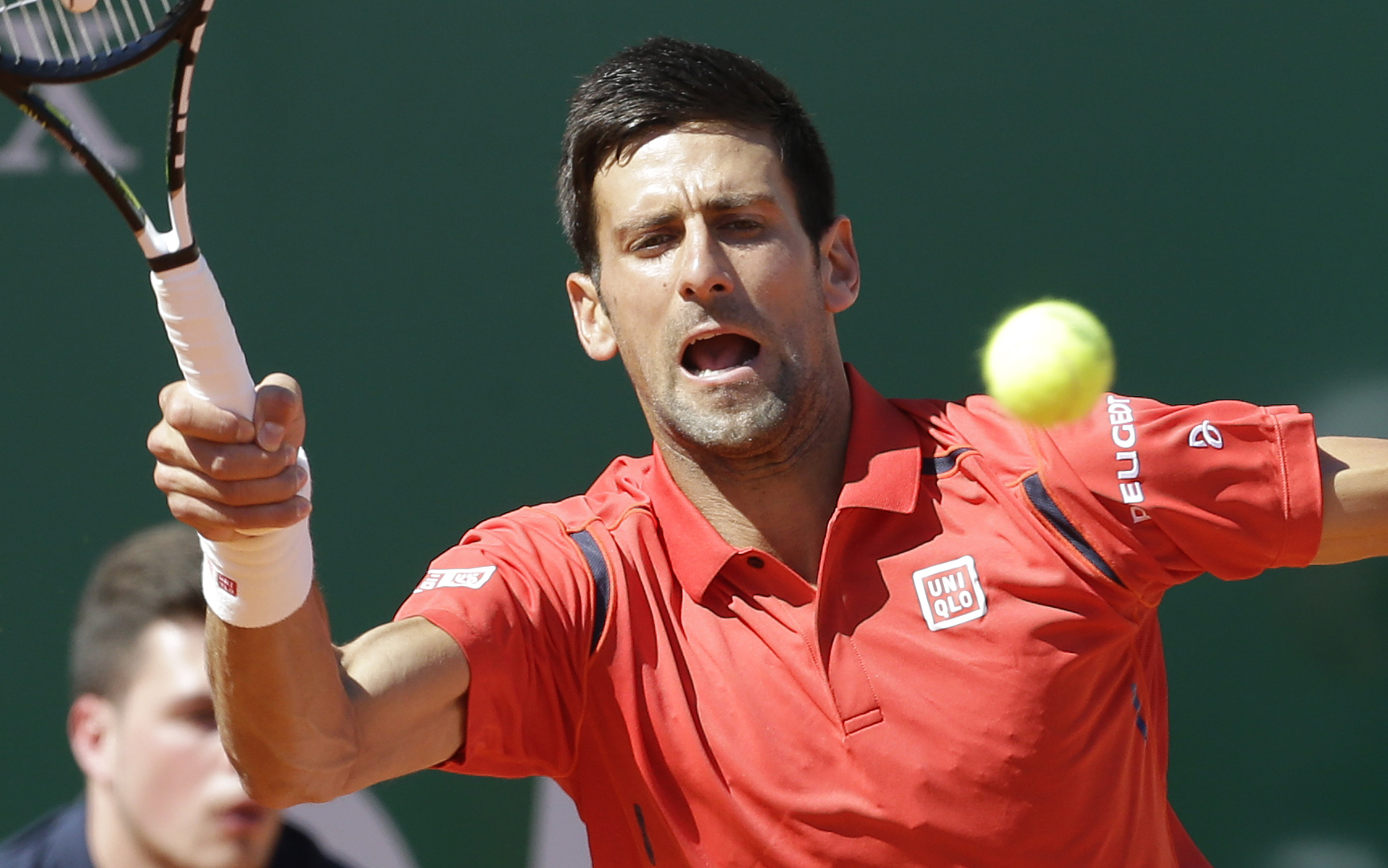 Novak Djokovic of Serbia plays a return to Jiri Vesely of Czech Republic during their match at the Monte Carlo Tennis Masters tournament in Monaco, Wednesday, April 13, 2016. (AP Photo/Lionel Cironneau)