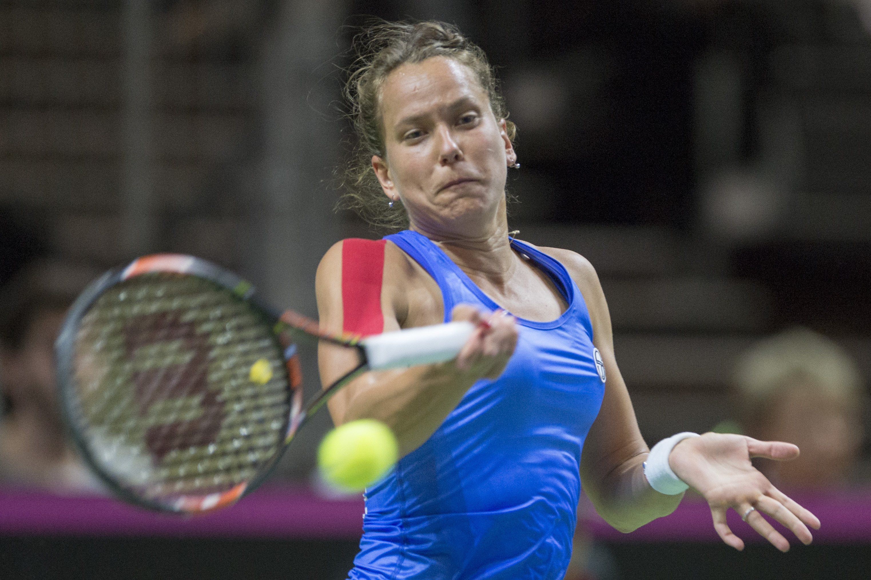 Barbora Strycova of the Czech Republic returns a ball to t Switzerland's Timea Bacsinszky, during their Fed Cup World Group semifinal tennis match between Switzerland and the Czech Republic, in Lucerne, Switzerland, Saturday, April 16, 2016. (Urs Flueeler