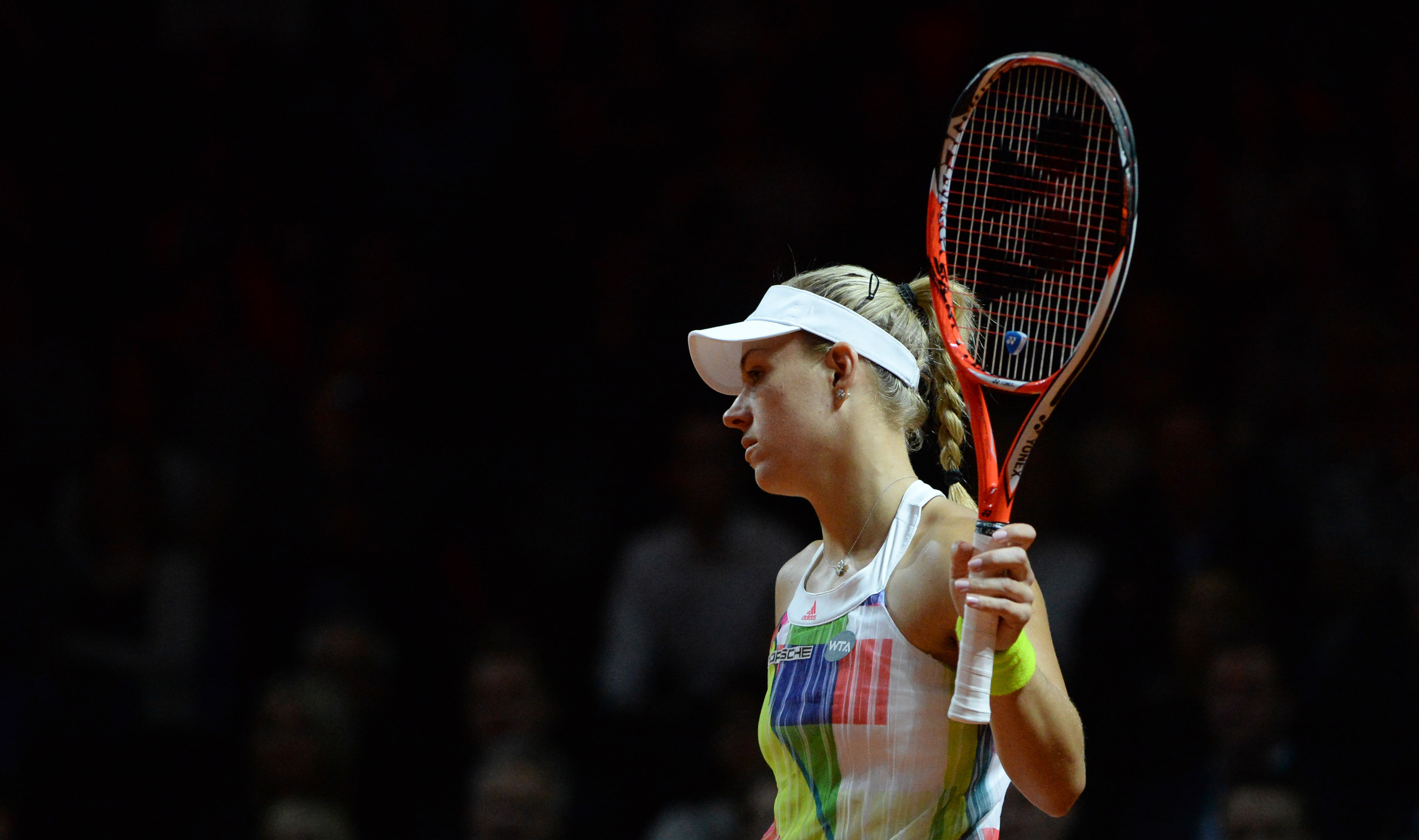 Angelique Kerber from Germany holds her rackted during her semifinal match against Petra Kvitova from Czech Republic at the WTA tennis tournament in Stuttgart, southern Germany, Saturday, April 23, 2016. (Marijan Murat/dpa via AP)