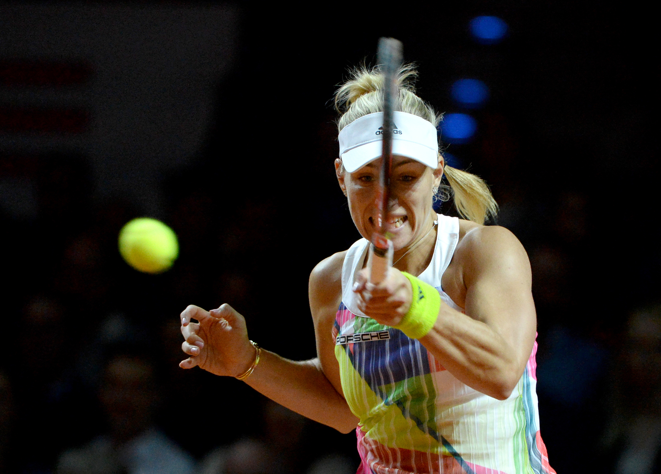 Germany's Angelique Kerber returns a ball to Germany's Laura Siegemund during their final at the WTA tennis tournament in Stuttgart, southern Germany, Sunday, April 24, 2016. (Marijan Murat/dpa via AP)