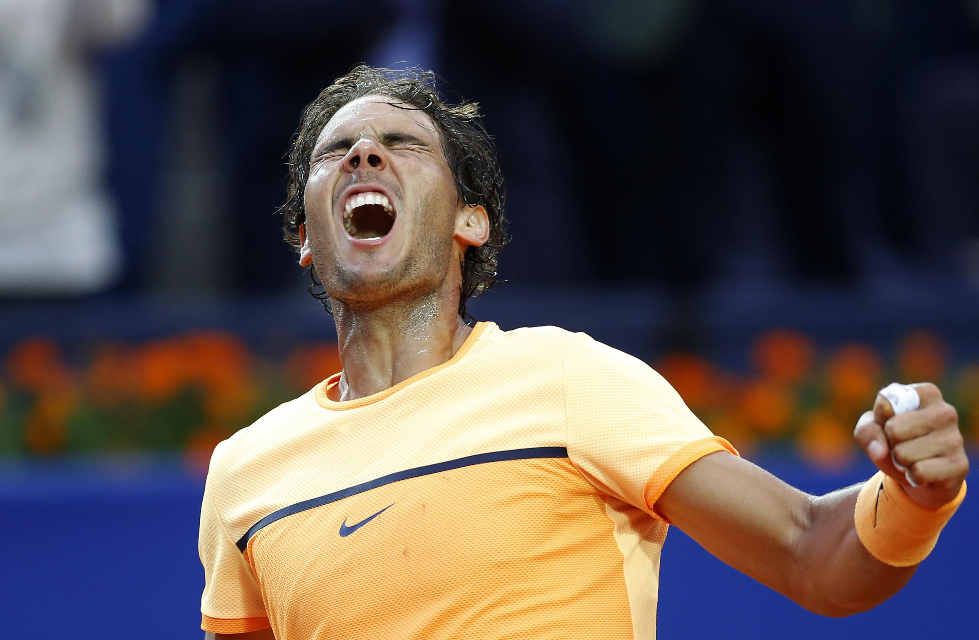 Spain's Rafael Nadal celebrates after winning the Barcelona Open tennis tournament in Barcelona, Spain, Sunday, April 24, 2016. Spain's Rafael Nadal defeated Japans Kei Nishikori 6-4 and 7-5, in the final. (AP Photo/Manu Fernandez)