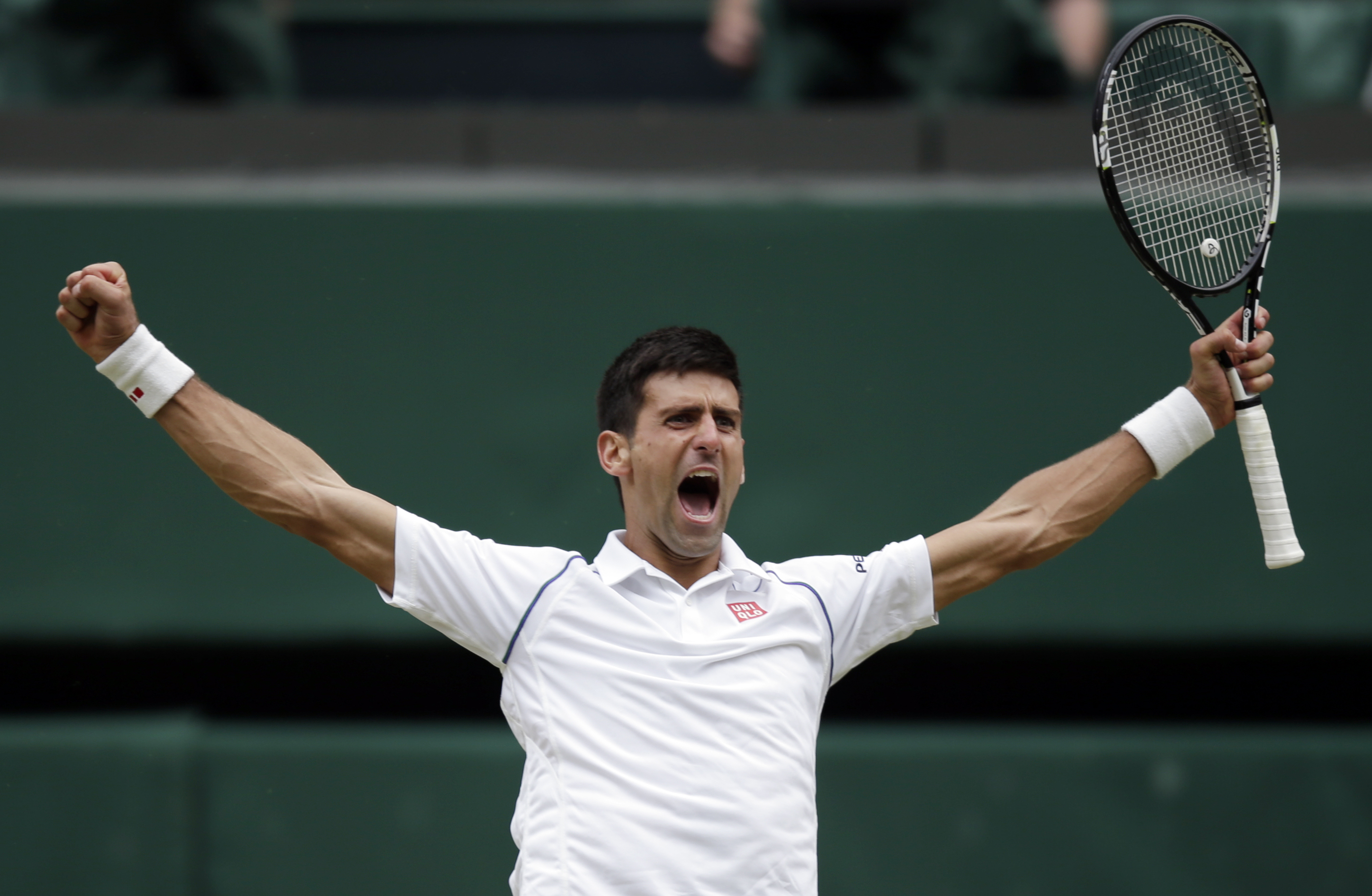 FILE - In this Sunday, July 12, 2015 file photo, Novak Djokovic of Serbia celebrates winning the men's singles final against Roger Federer of Switzerland at the All England Lawn Tennis Championships in Wimbledon, London.  Prize money at Wimbledon is incre