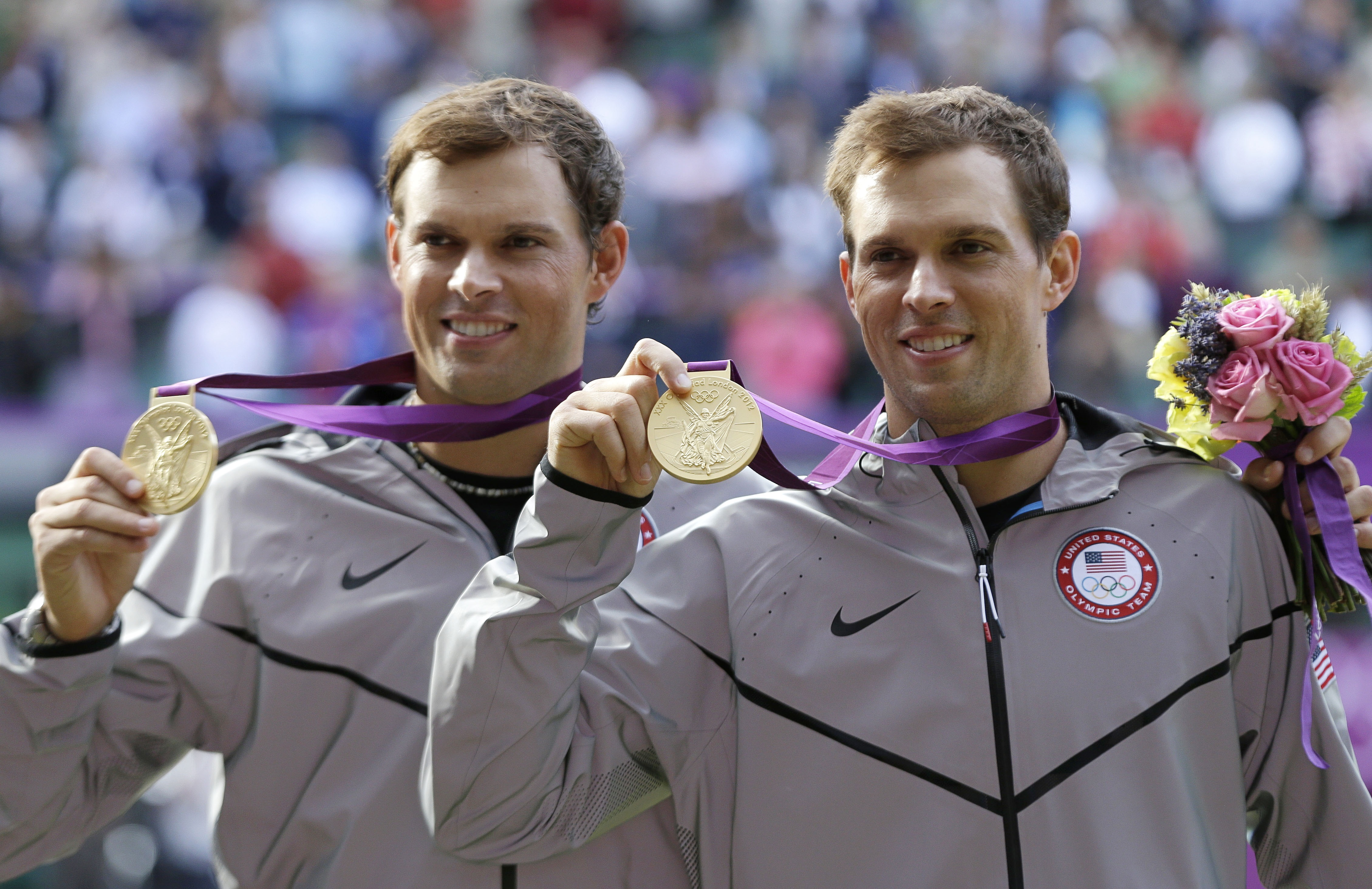 Gold medalists Mike Bryan, right, and Bob Bryan, left, of the United States, pose after the medal ceremony of the men's doubles final match at the All England Lawn Tennis Club at Wimbledon, in London, at the 2012 Summer Olympics, Saturday, Aug. 4, 2012. (