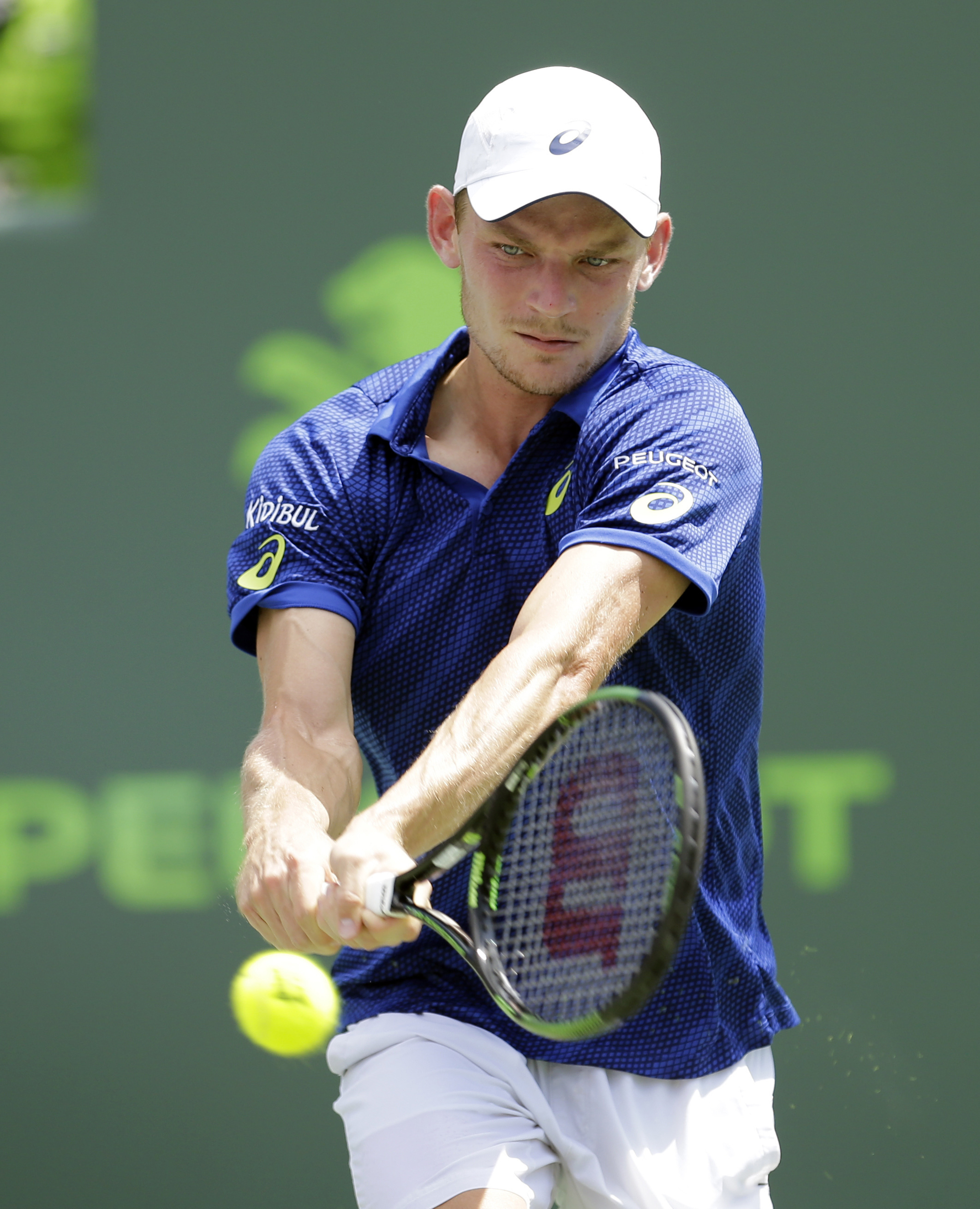 David Goffin, of Belgium, returns to Novak Djokovic, of Serbia, during a semifinal match at the Miami Open tennis tournament in Key Biscayne, Fla., Friday, April 1, 2016. Djokovic won a thrilling tiebreaker and advanced to the Miami Open final by beating