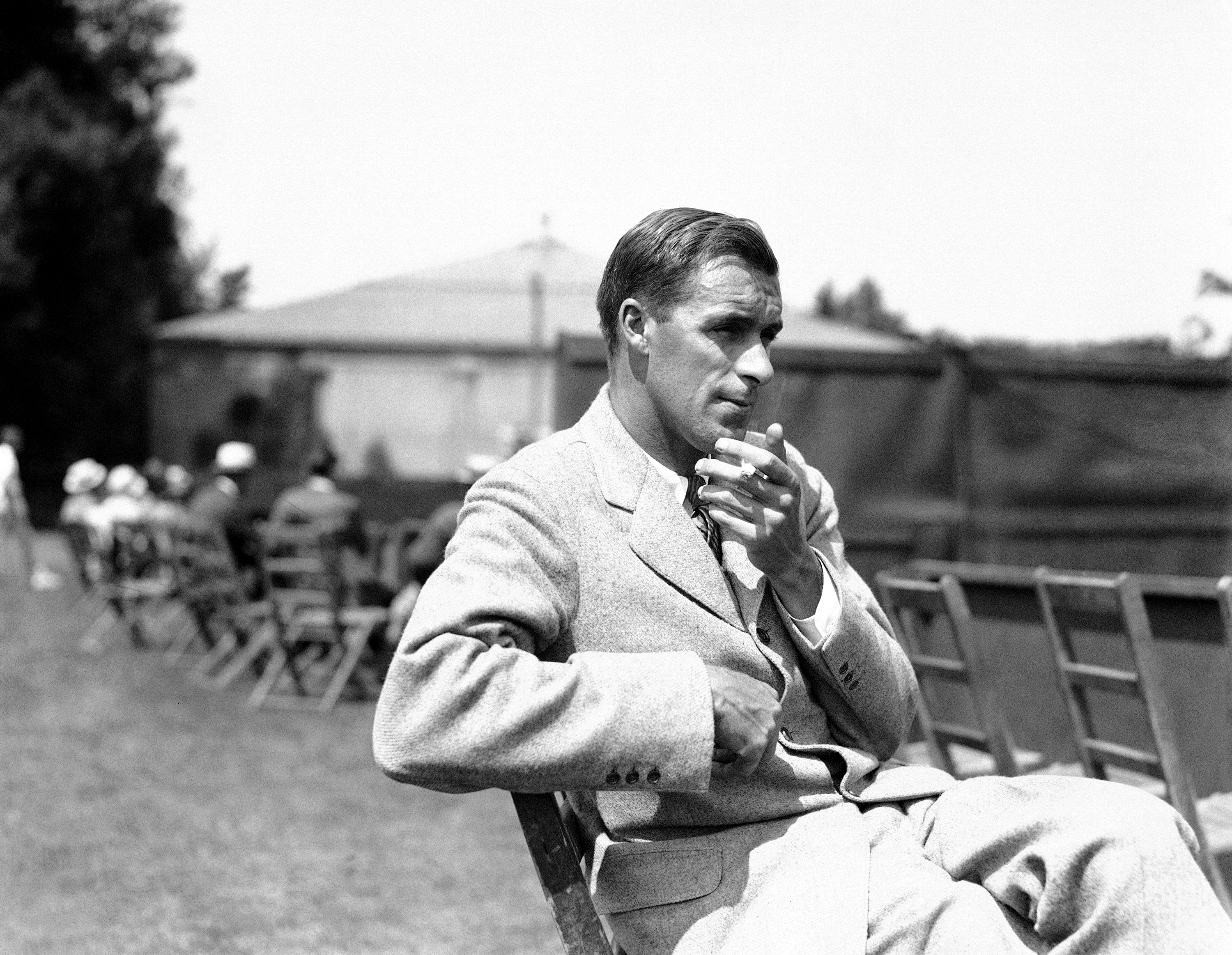 FILE - In this June 1925 file photo, Bill Tilden watches a match in Philadelphia, during the National Doubles Tennis matches. A group is pushing for a historical marker touting the accomplishments of tennis great Bill Tilden at Philadelphia's Germantown C