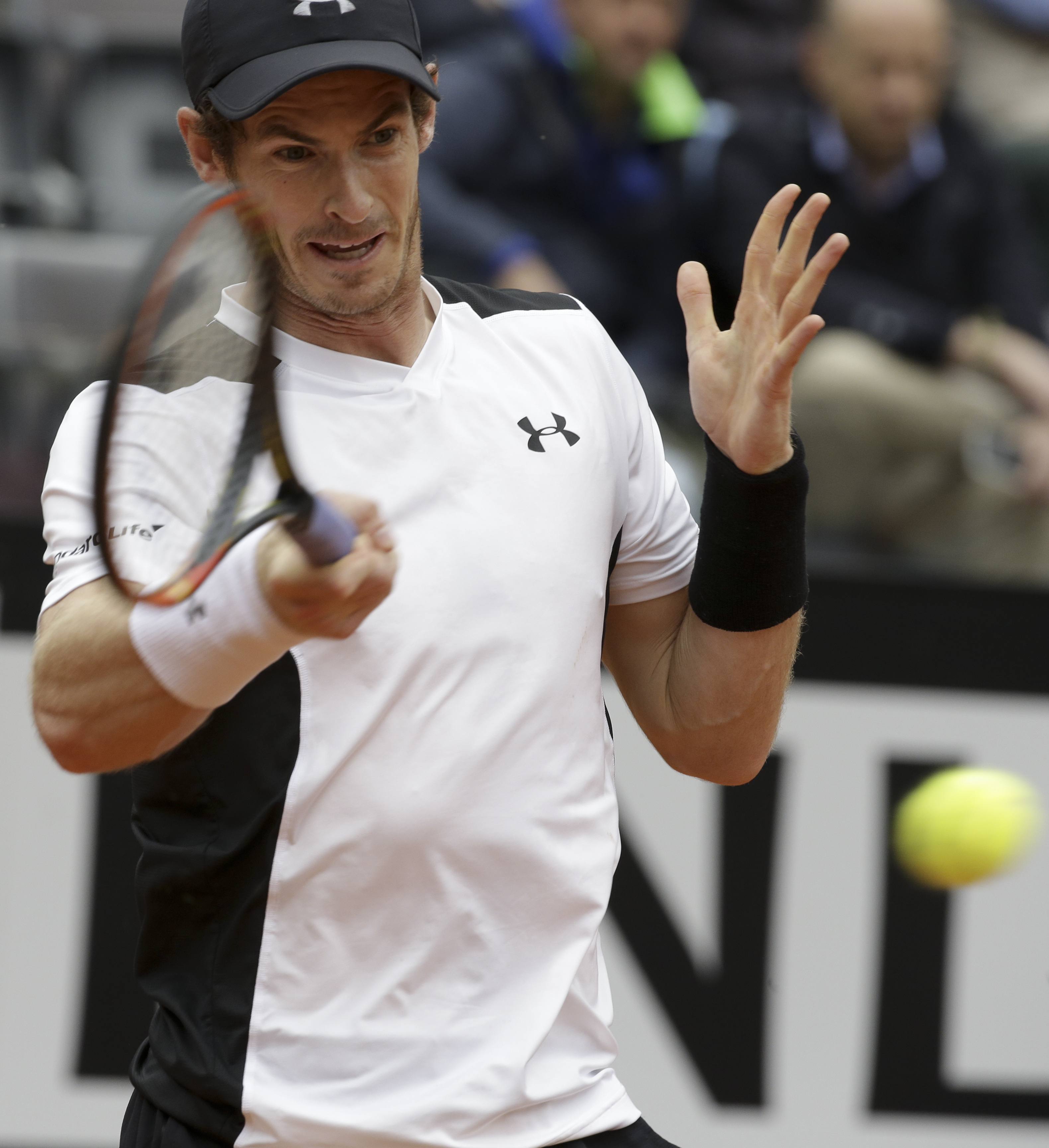 Andy Murray returns the ball to Lucas Pouille during their semifinal match at the Italian Open tennis tournament, in Rome, Saturday, May 14, 2016. (AP Photo/Alessandra Tarantino)
