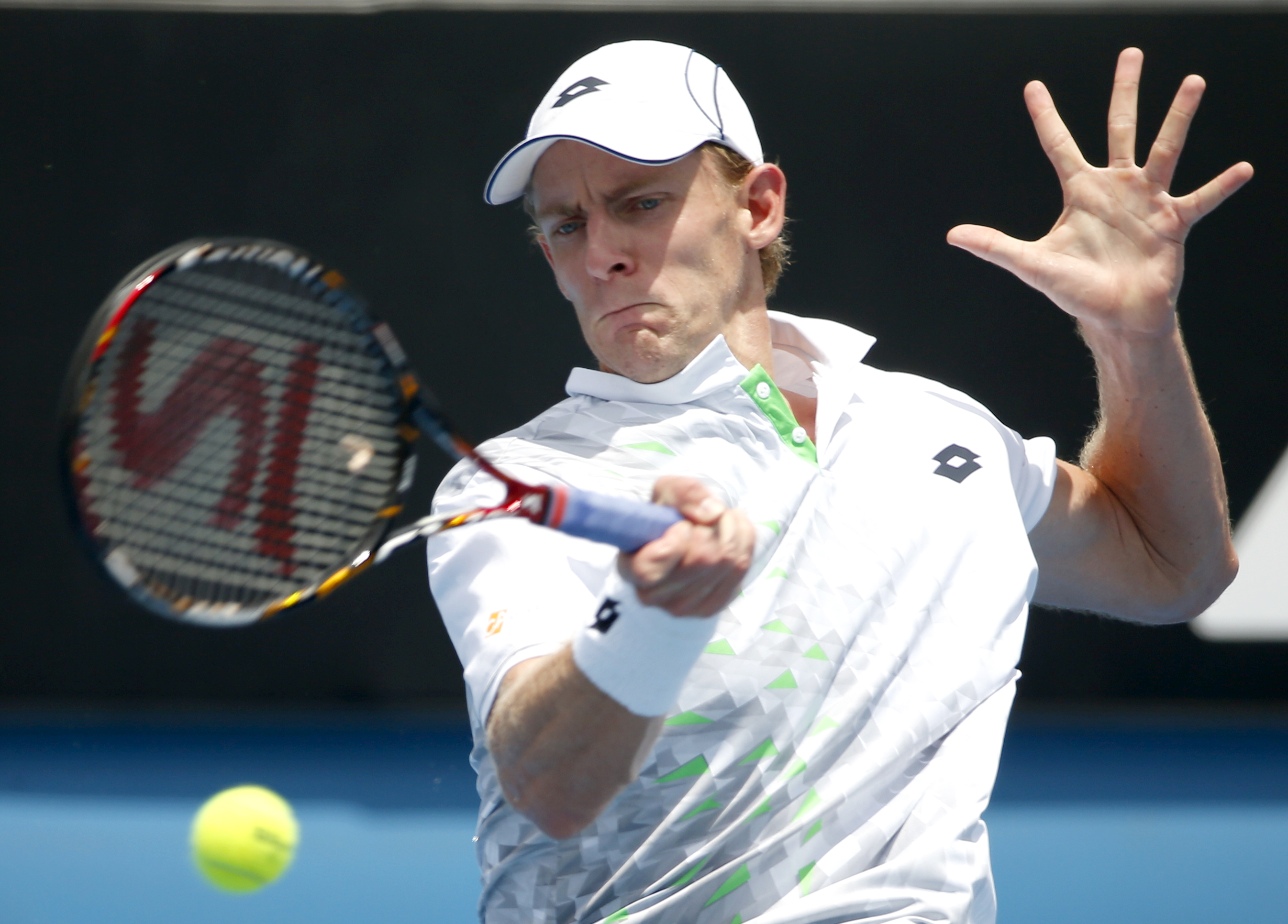 Kevin Anderson of South Africa makes a forehand return to Rajeev Ram of the United States  during their first round match at the Australian Open tennis championships in Melbourne, Australia, Tuesday, Jan. 19, 2016.(AP Photo/Vincent Thian)